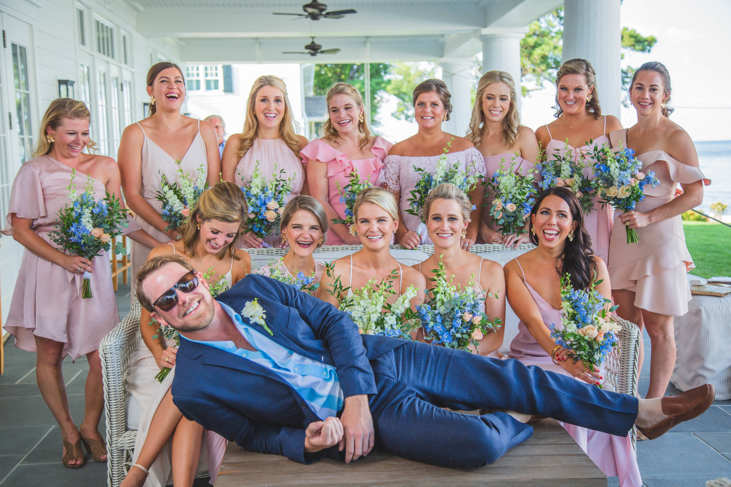 Bride and bridesmaids pose with groom