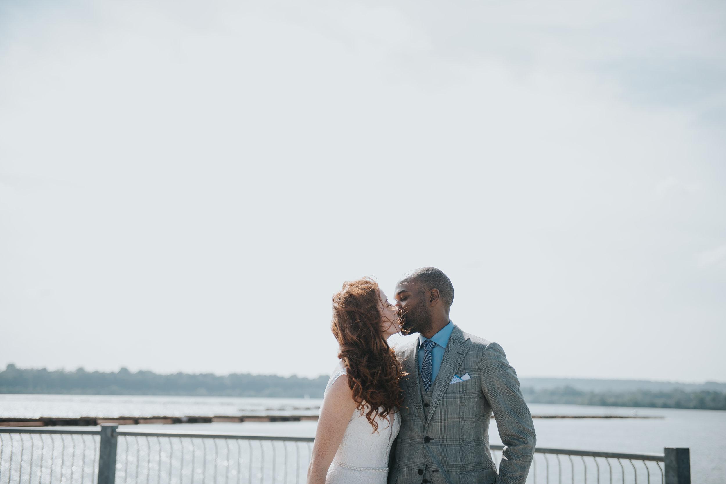 bride-groom-kissing-toronto-outdoor-summer-wedding-documentary-wedding-photography-by-willow-birch-photo.jpg