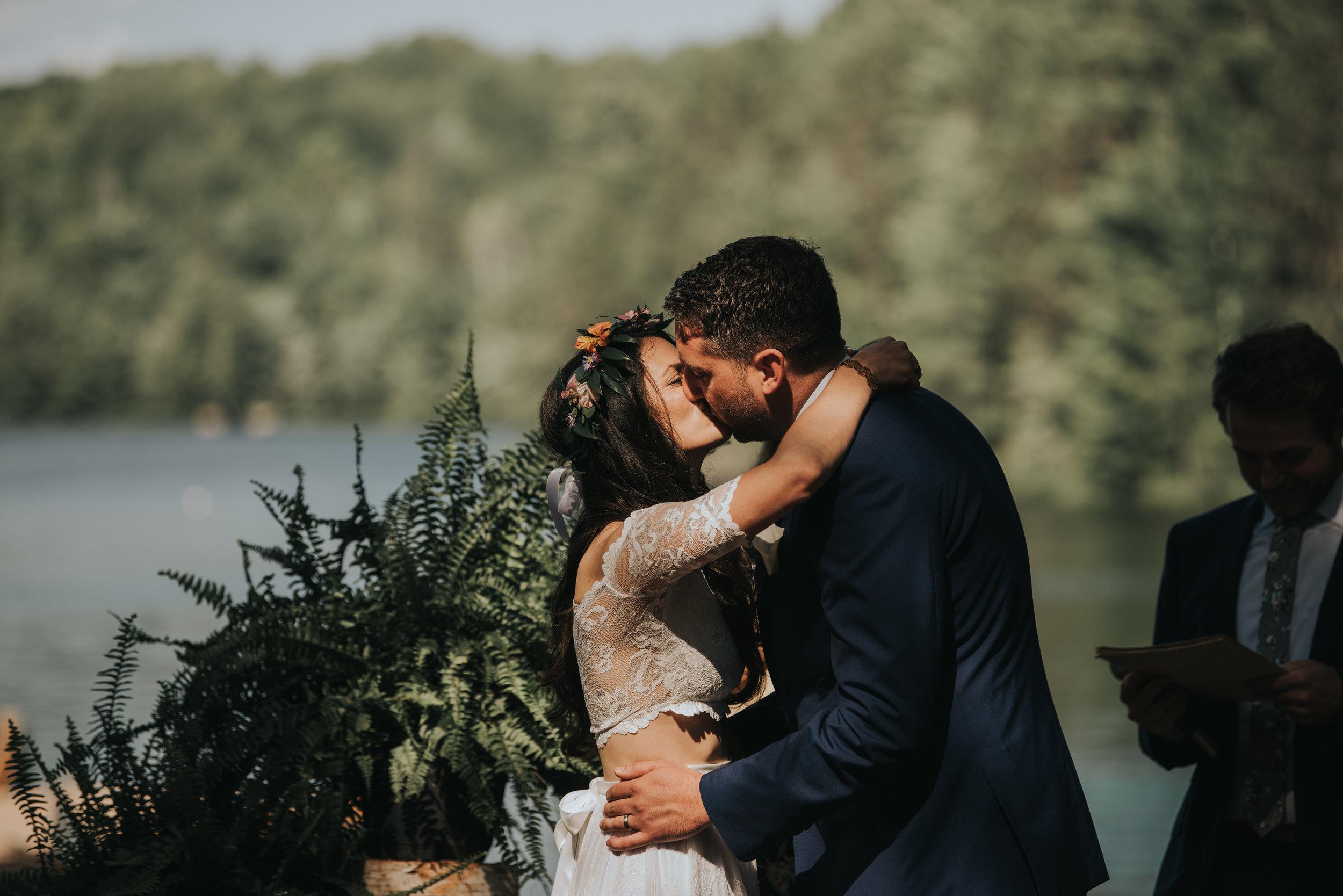 bride-and-groom-first-kiss-toronto-bohemian-boho-outdoor-summer-wedding-documentary-wedding-photography-by-willow-birch-photo.jpg