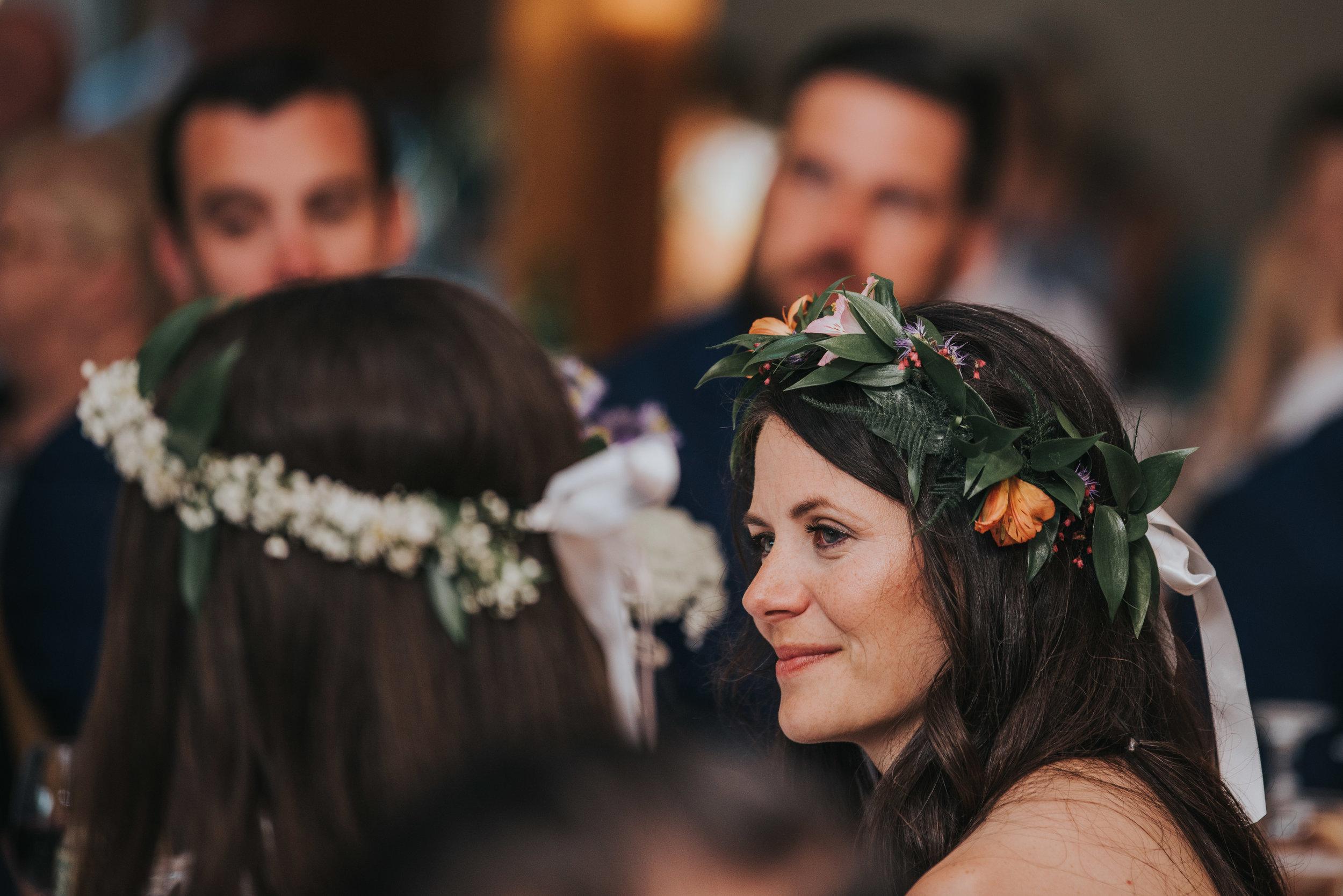 bride-at-reception-rustic-cabin-toronto-bohemian-boho-outdoor-summer-wedding-documentary-wedding-photography-by-willow-birch-photo.jpg