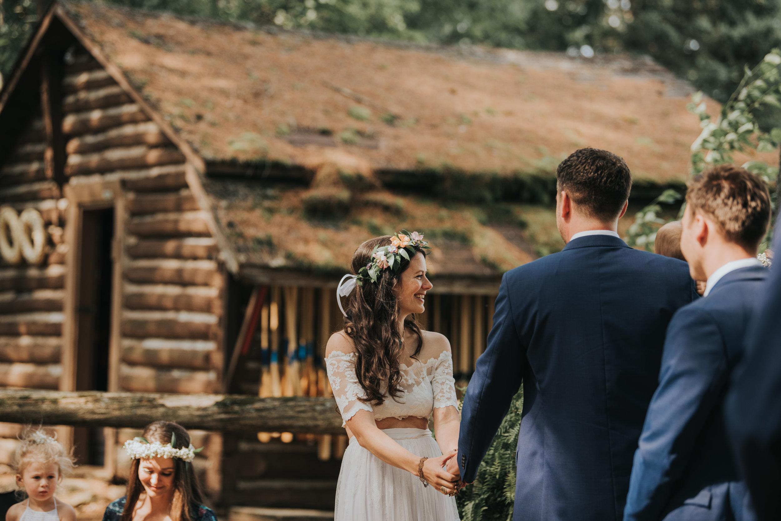 bride-exchanging-vows-toronto-bohemian-boho-outdoor-summer-wedding-documentary-wedding-photography-by-willow-birch-photo.jpg