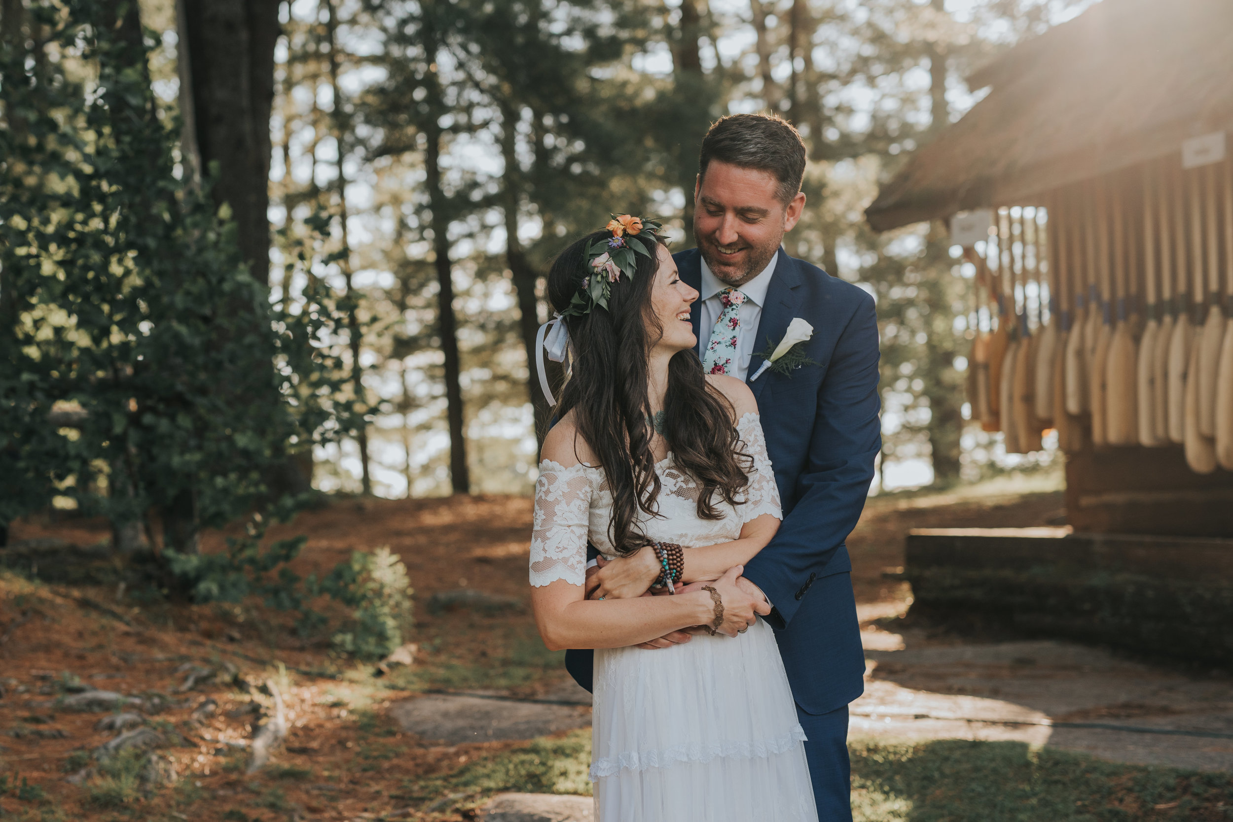 bride-groom-cuddling-rustic-cabin-toronto-bohemian-boho-outdoor-summer-wedding-documentary-wedding-photography-by-willow-birch-photo.jpg