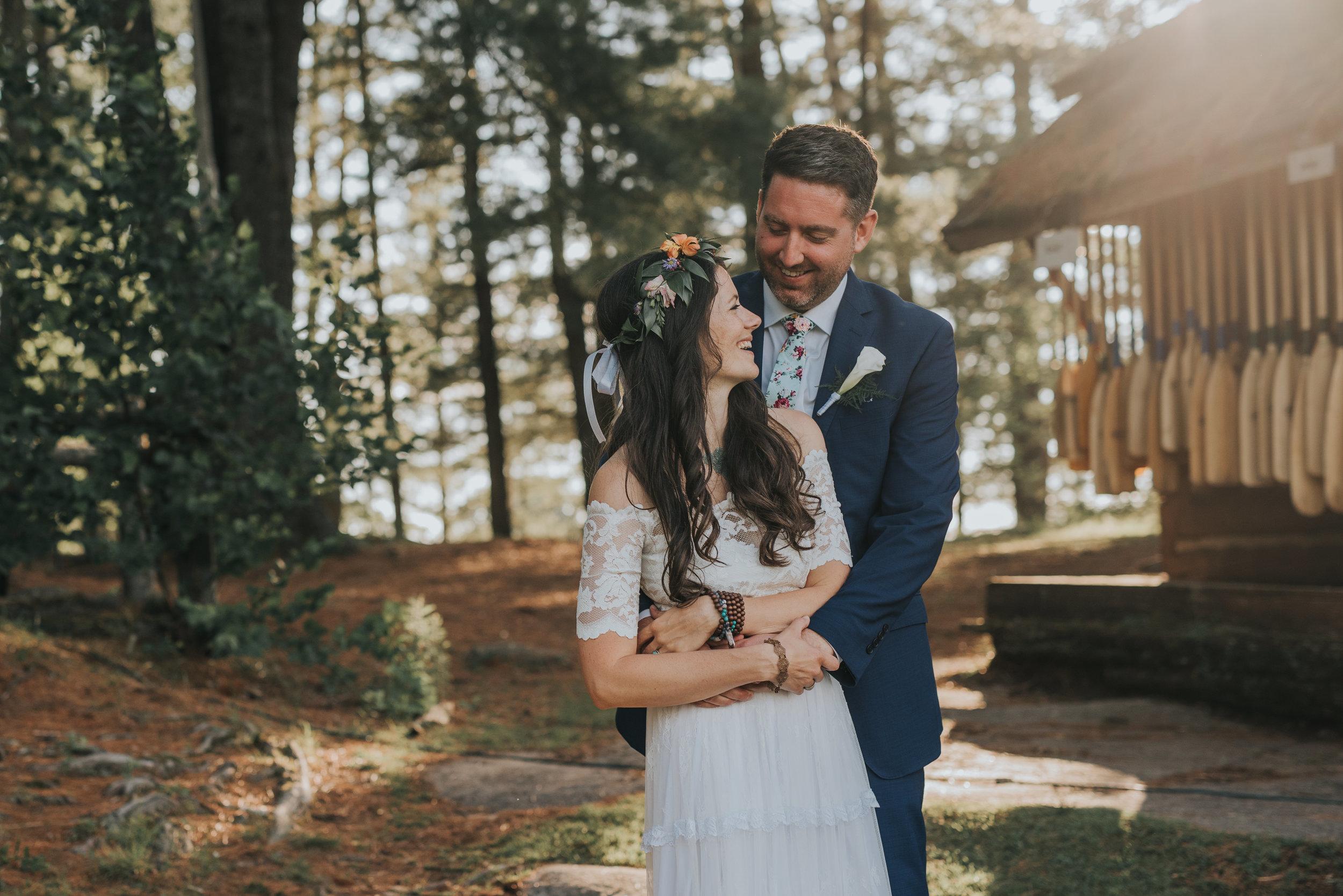 bride-groom-cuddling-rustic-cabin-toronto-bohemian-boho-outdoor-summer-wedding-documentary-wedding-photography-by-willow-birch-photo.jpg