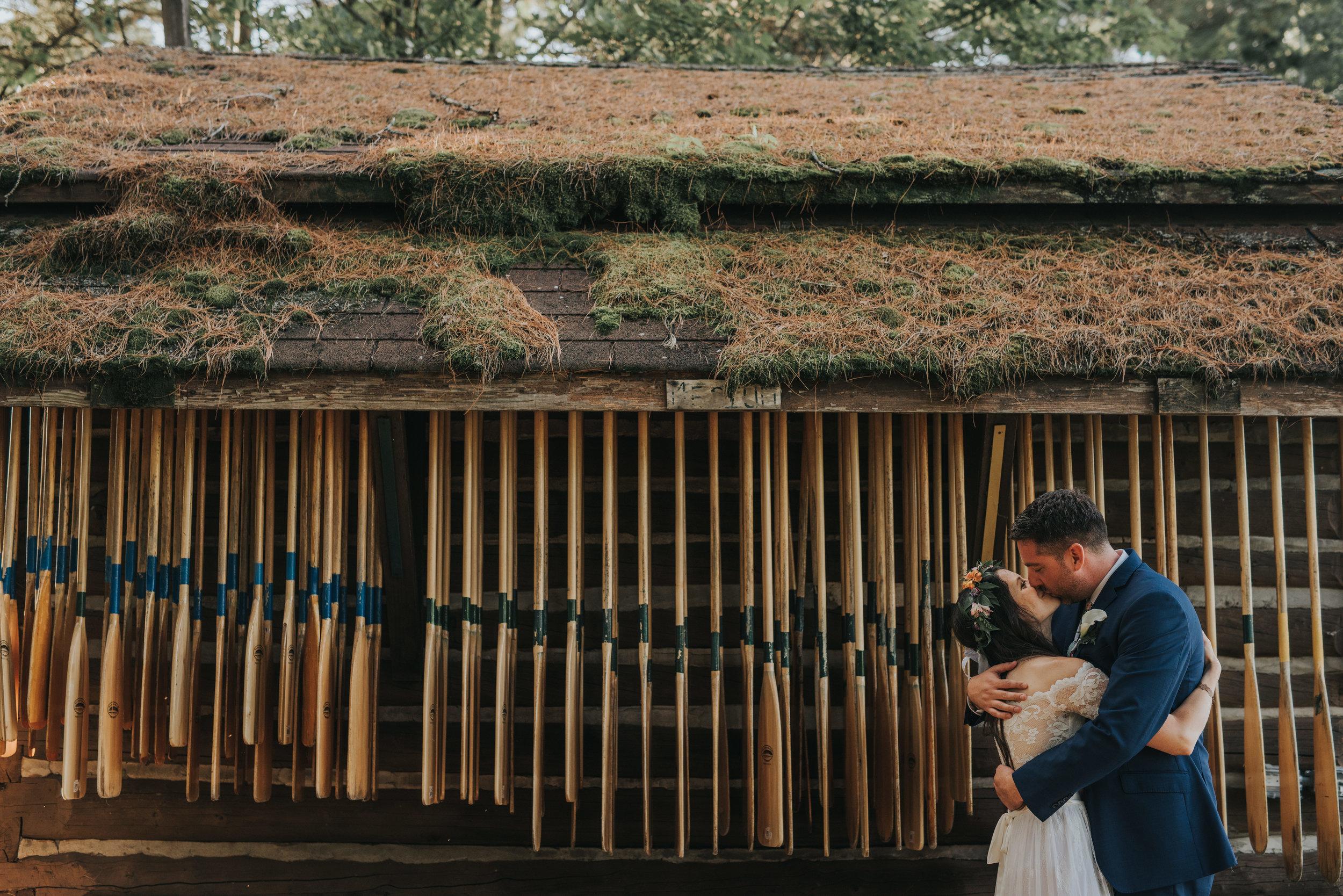 bride-groom-kissing-rustic-cabin-wedding-toronto-bohemian-boho-outdoor-summer-wedding-documentary-wedding-photography-by-willow-birch-photo.jpg