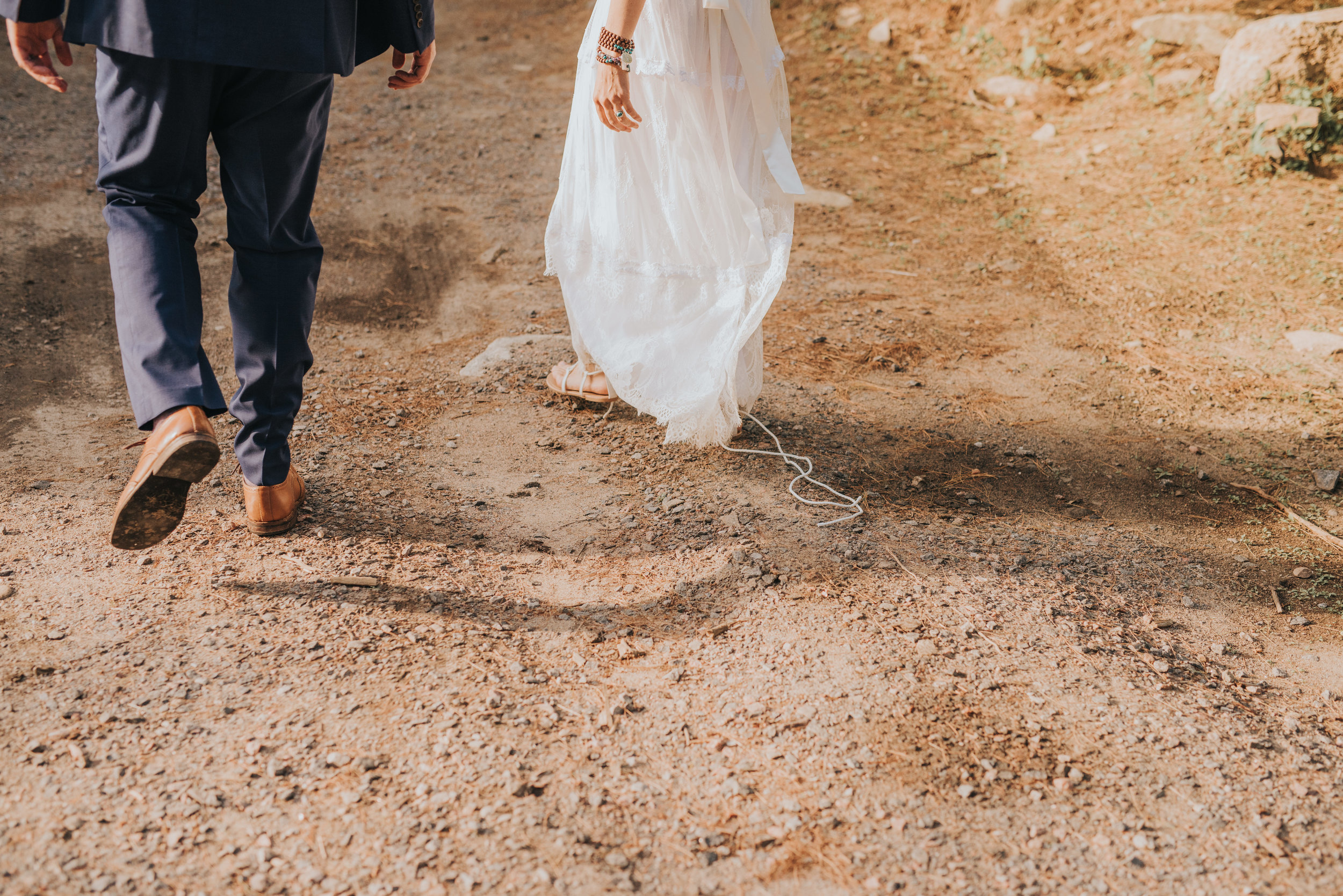 bride-groom-walking-together-rustic-cabin-toronto-bohemian-boho-outdoor-summer-wedding-documentary-wedding-photography-by-willow-birch-photo.jpg