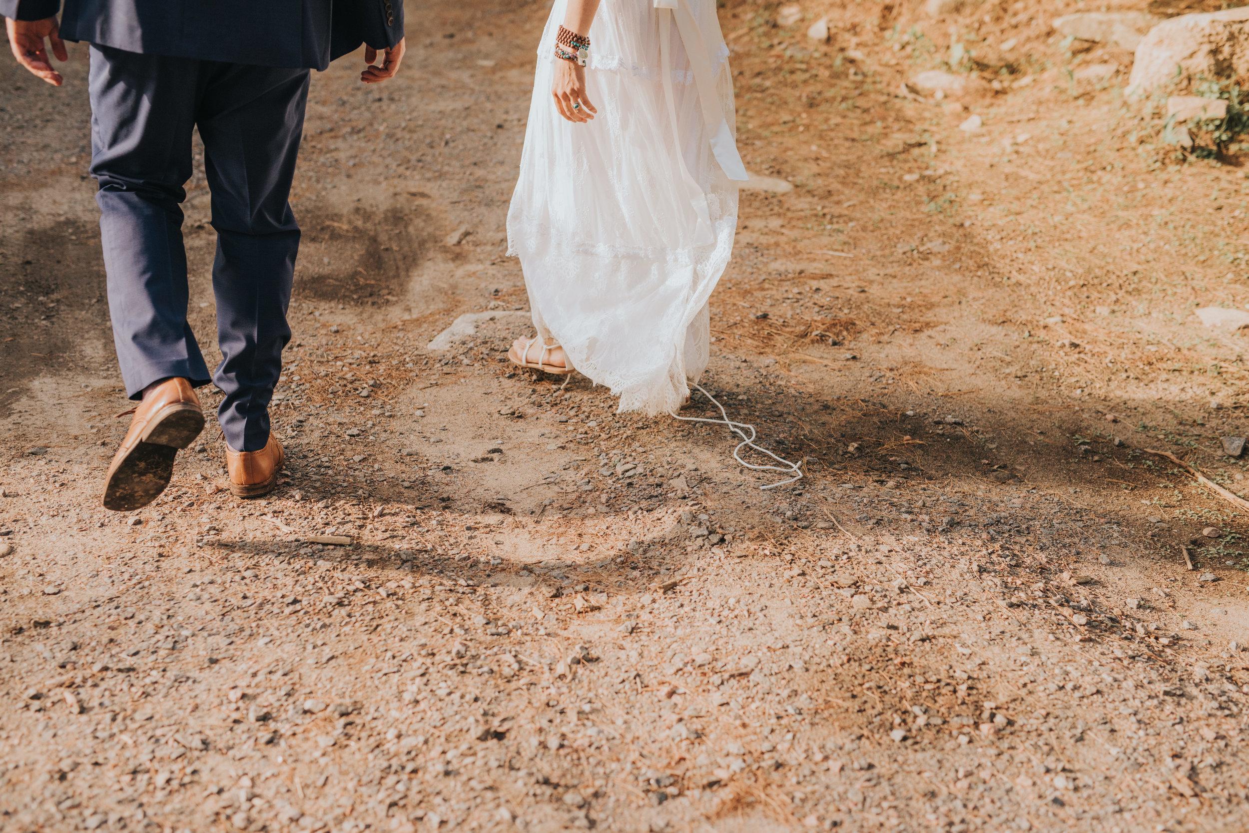 bride-groom-walking-together-rustic-cabin-toronto-bohemian-boho-outdoor-summer-wedding-documentary-wedding-photography-by-willow-birch-photo.jpg