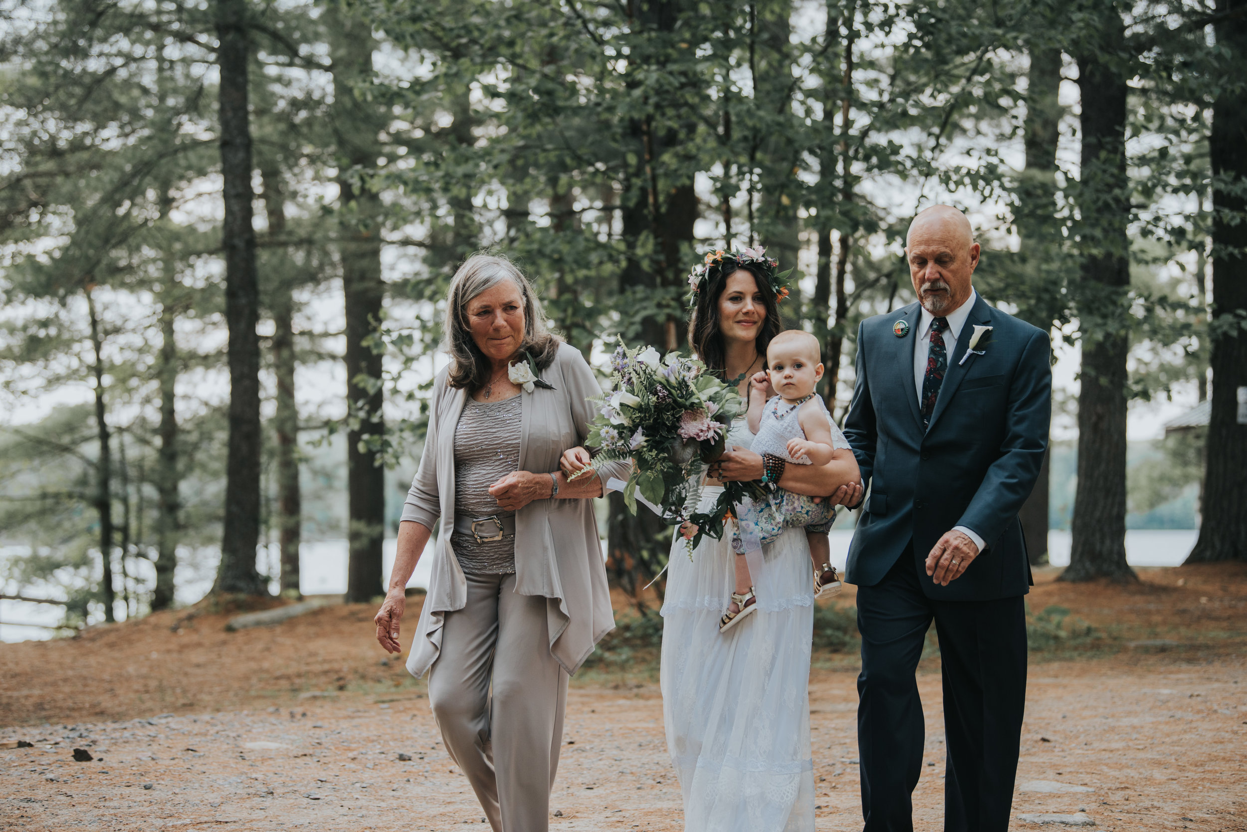 bride-waking-down-aisle-toronto-bohemian-boho-outdoor-summer-wedding-documentary-wedding-photography-by-willow-birch-photo.jpg