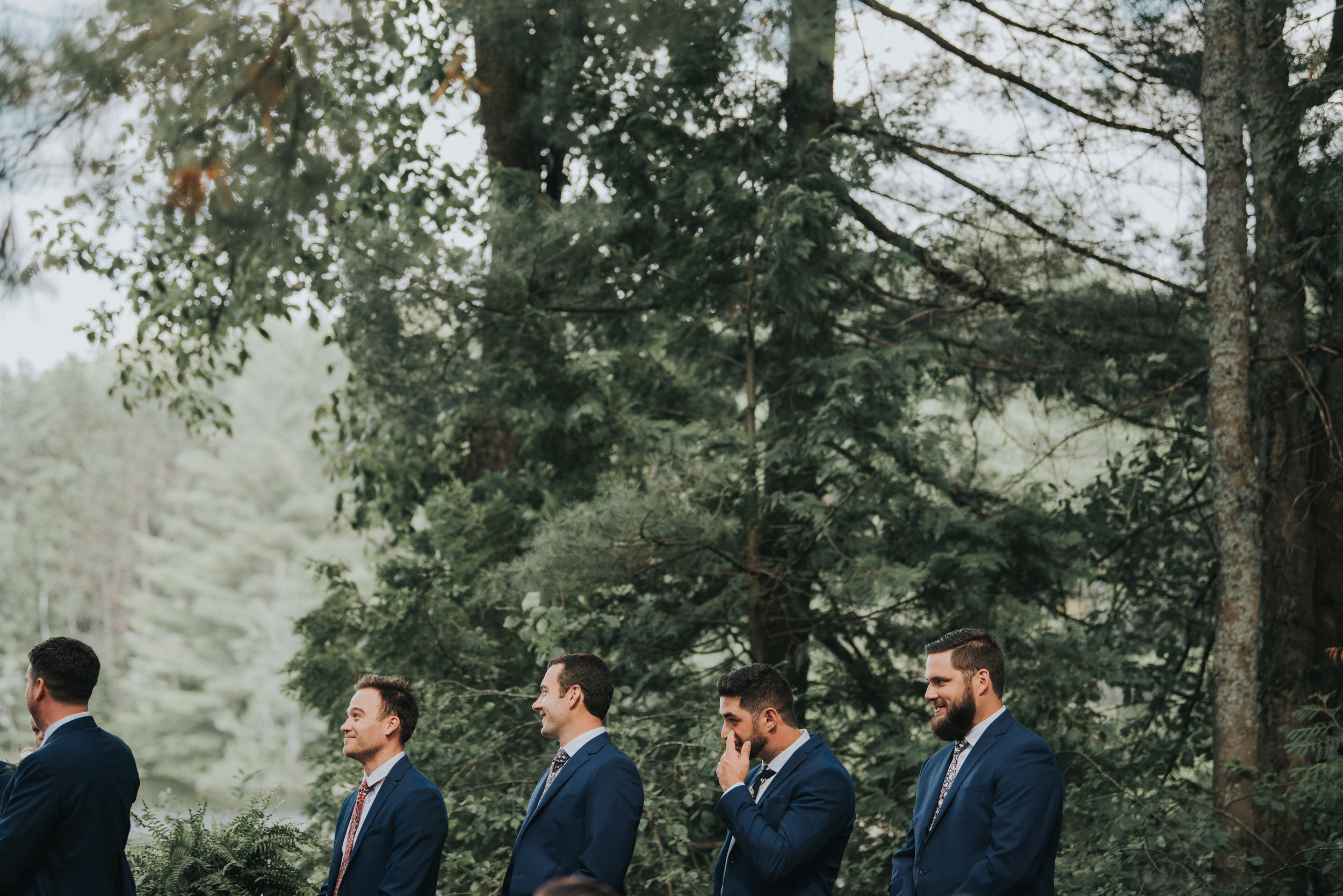 groomsmen-during-ceremony-toronto-bohemian-boho-outdoor-summer-wedding-documentary-wedding-photography-by-willow-birch-photo.jpg