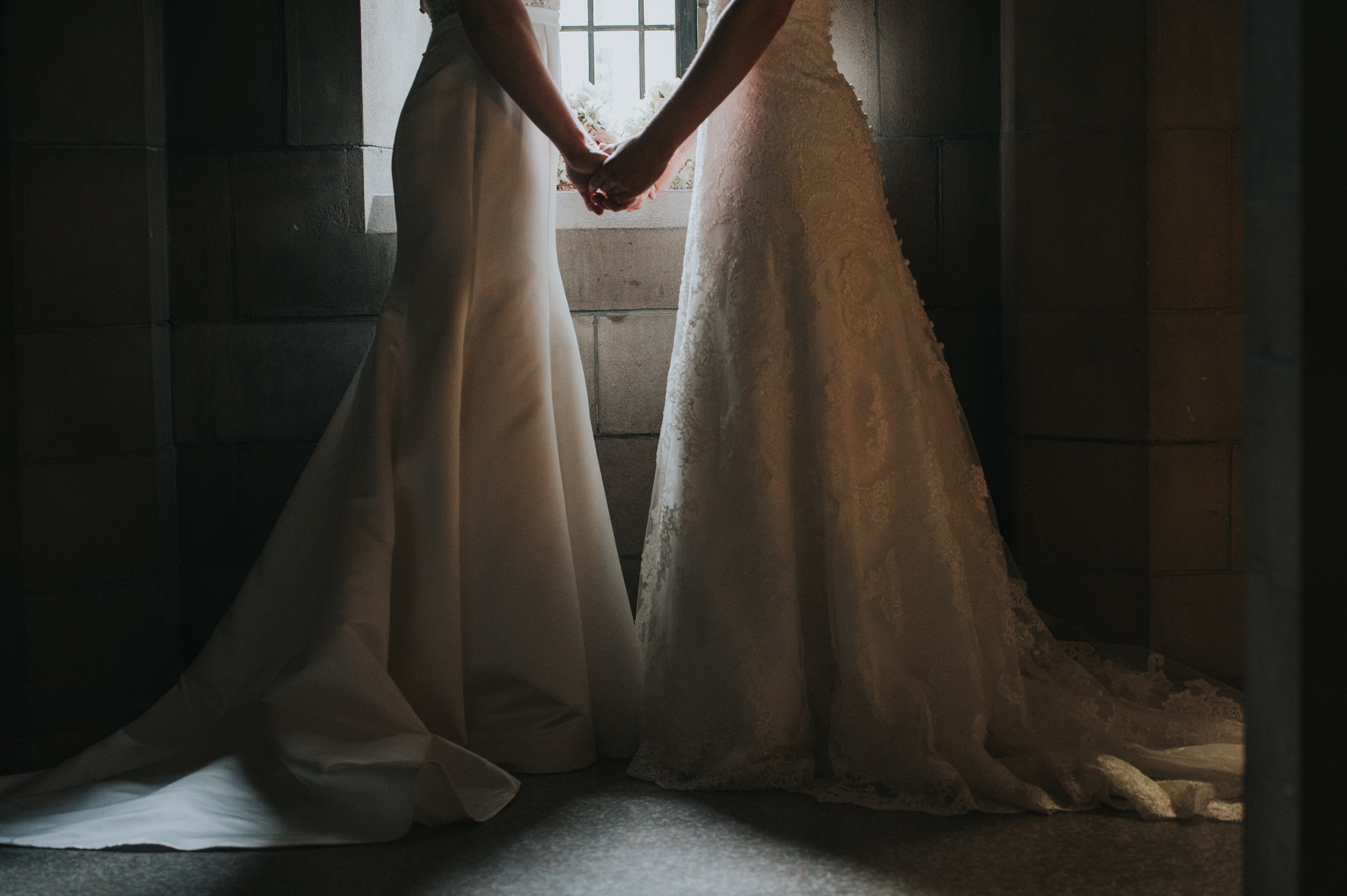 brides-holding-hands-knox-college-toronto-same-sex-wedding-willow-and-birch-photography-documentary-wedding-photographers.jpg