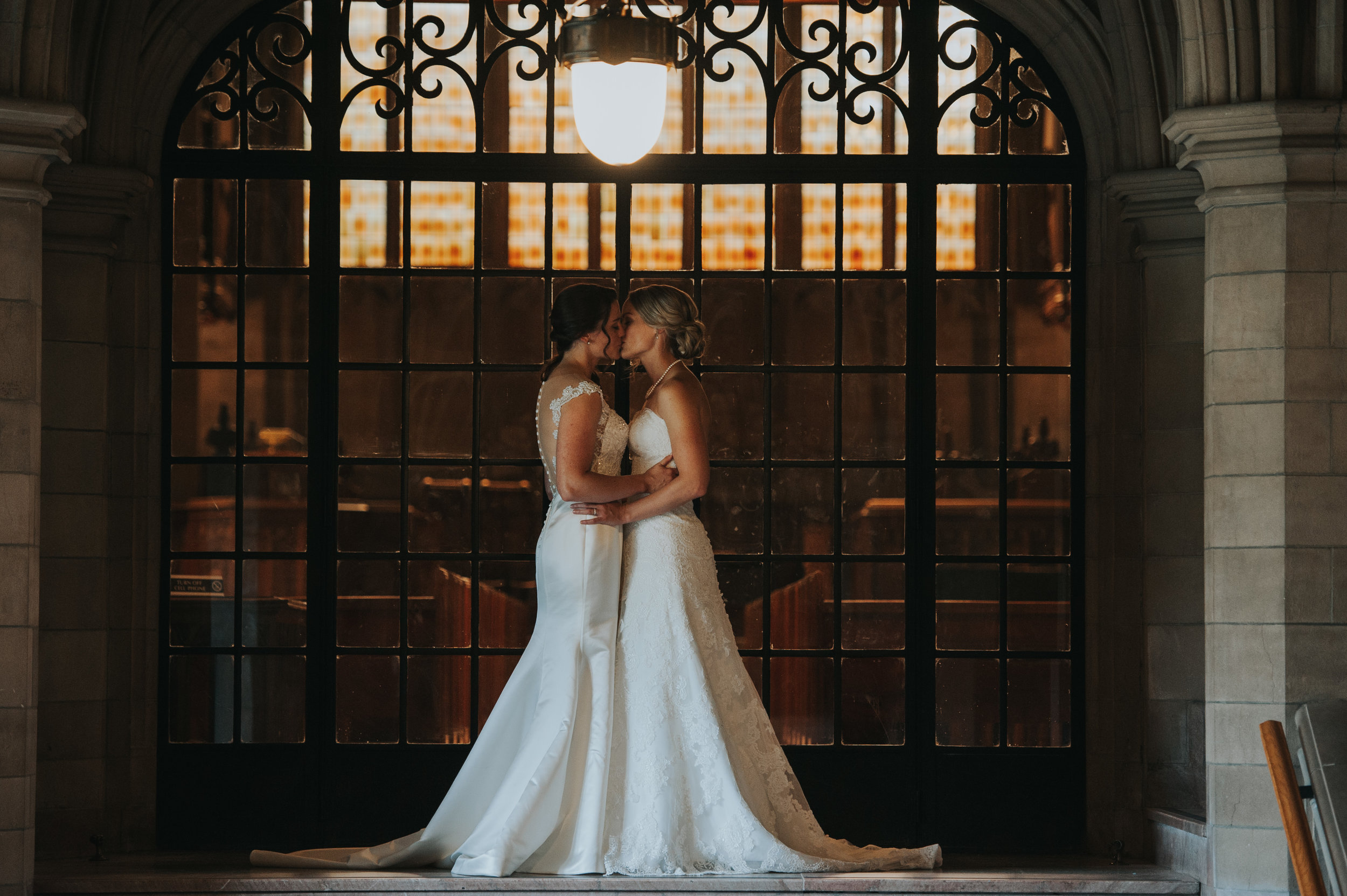 brides-kissing-toronto-same-sex-wedding-willow-and-birch-photography-documentary-wedding-photographers.jpg