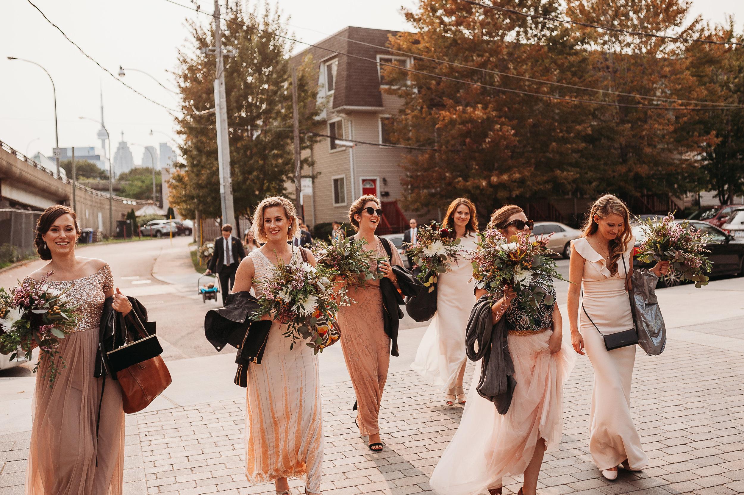 bridal-party-walking-to-portraits-toronto-rustic-boho-airship37-wedding-by-willow-birch-photo-toronto-documentary-wedding-photographers.jpg