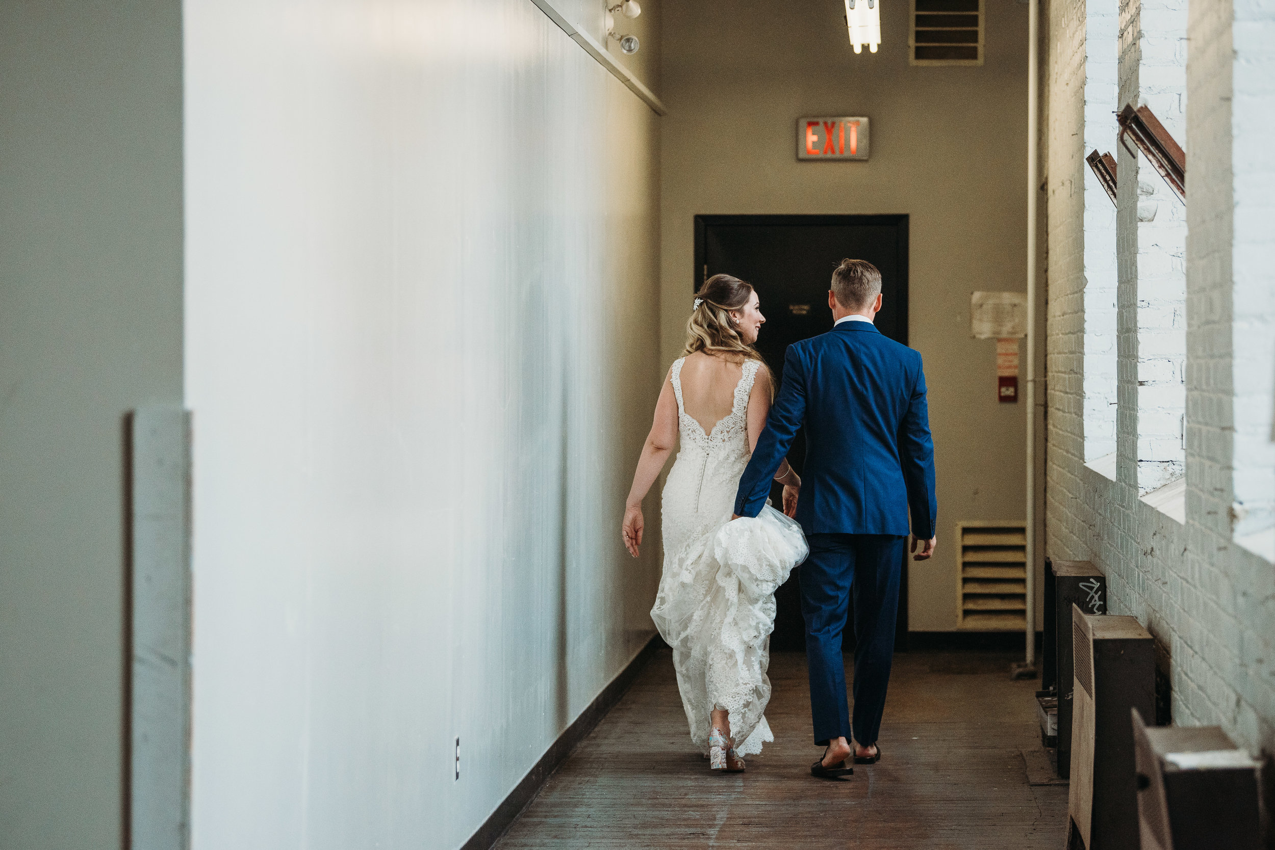 bride-groom-walking-toronto-rustic-boho-airship37-wedding-by-willow-birch-photo-toronto-documentary-wedding-photographers.jpg