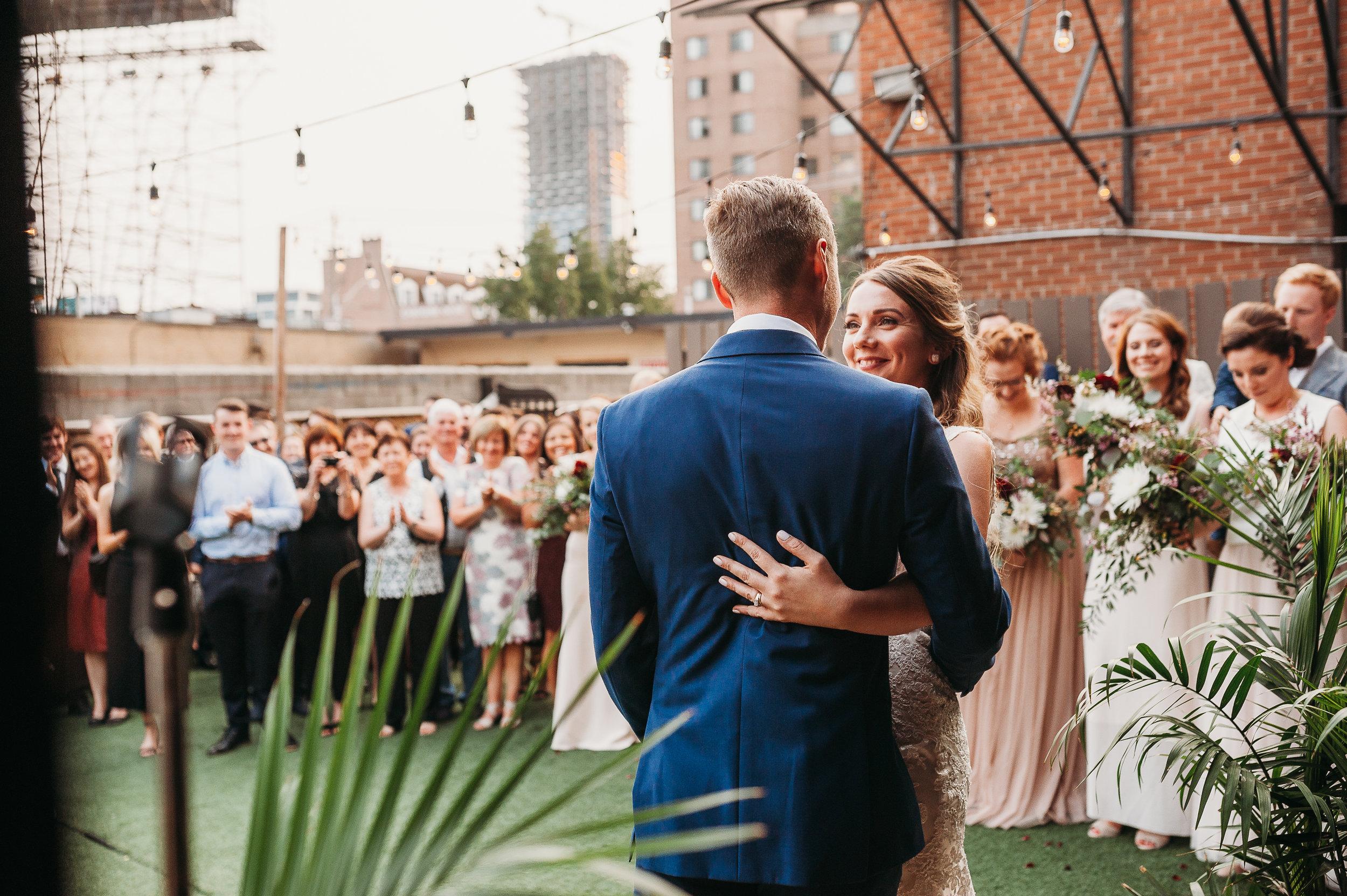 bride-groom-wedding-ceremony-first-kiss-toronto-rustic-boho-airship37-wedding-by-willow-birch-photo-toronto-documentary-wedding-photographers.jpg