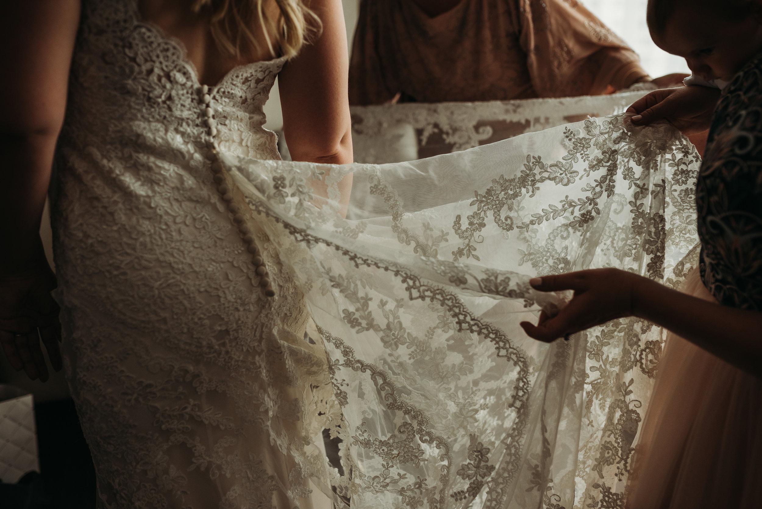 bride-lace-wedding-dress-getting-ready-photos-toronto-rustic-boho-airship37-wedding-by-willow-birch-photo-toronto-documentary-wedding-photographers.jpg