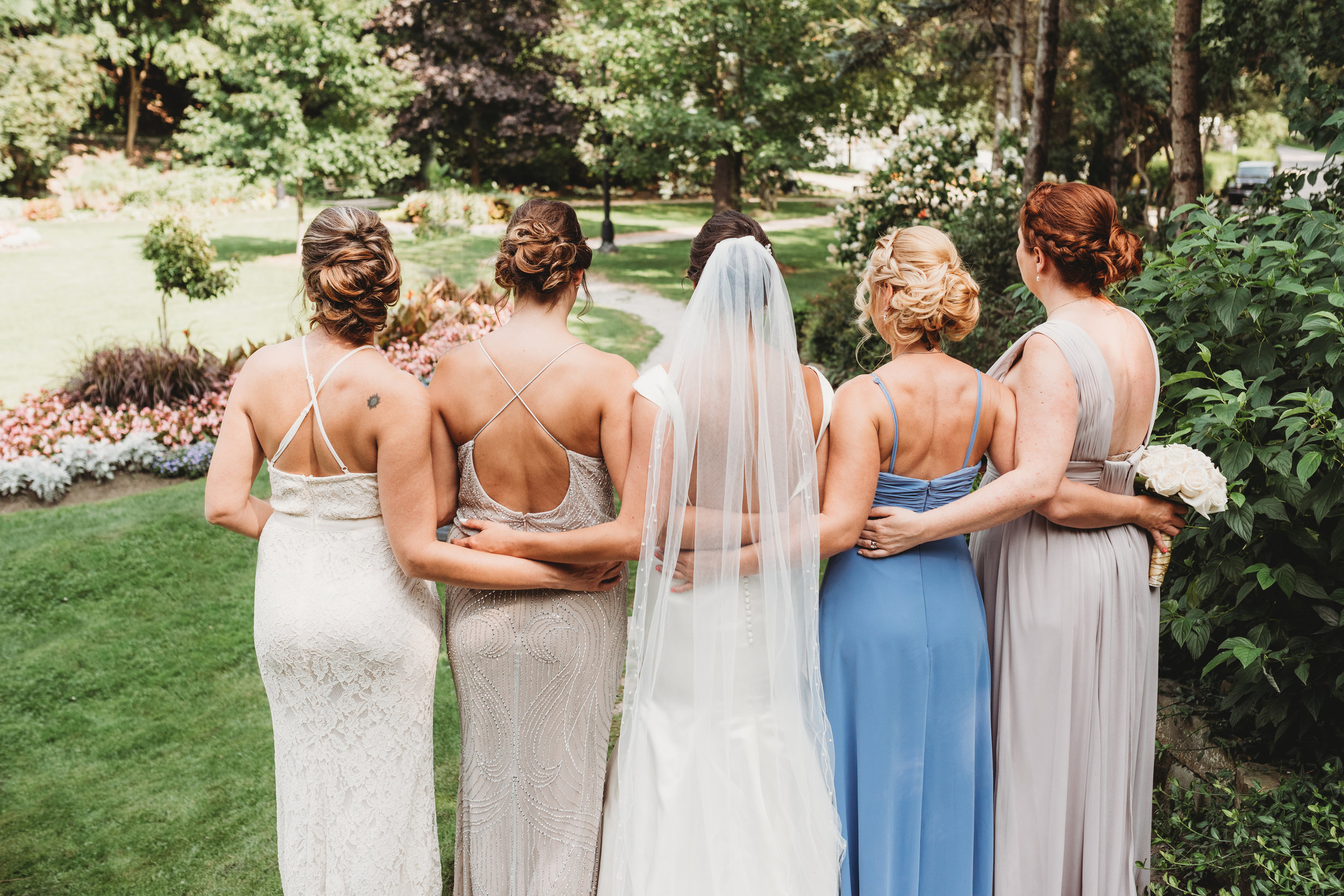 bride-and-bridesmaids-wedding-party-pictures-eglington-grand-wedding-by-willow-birch-photo-toronto-documentary-wedding-photographers.jpg