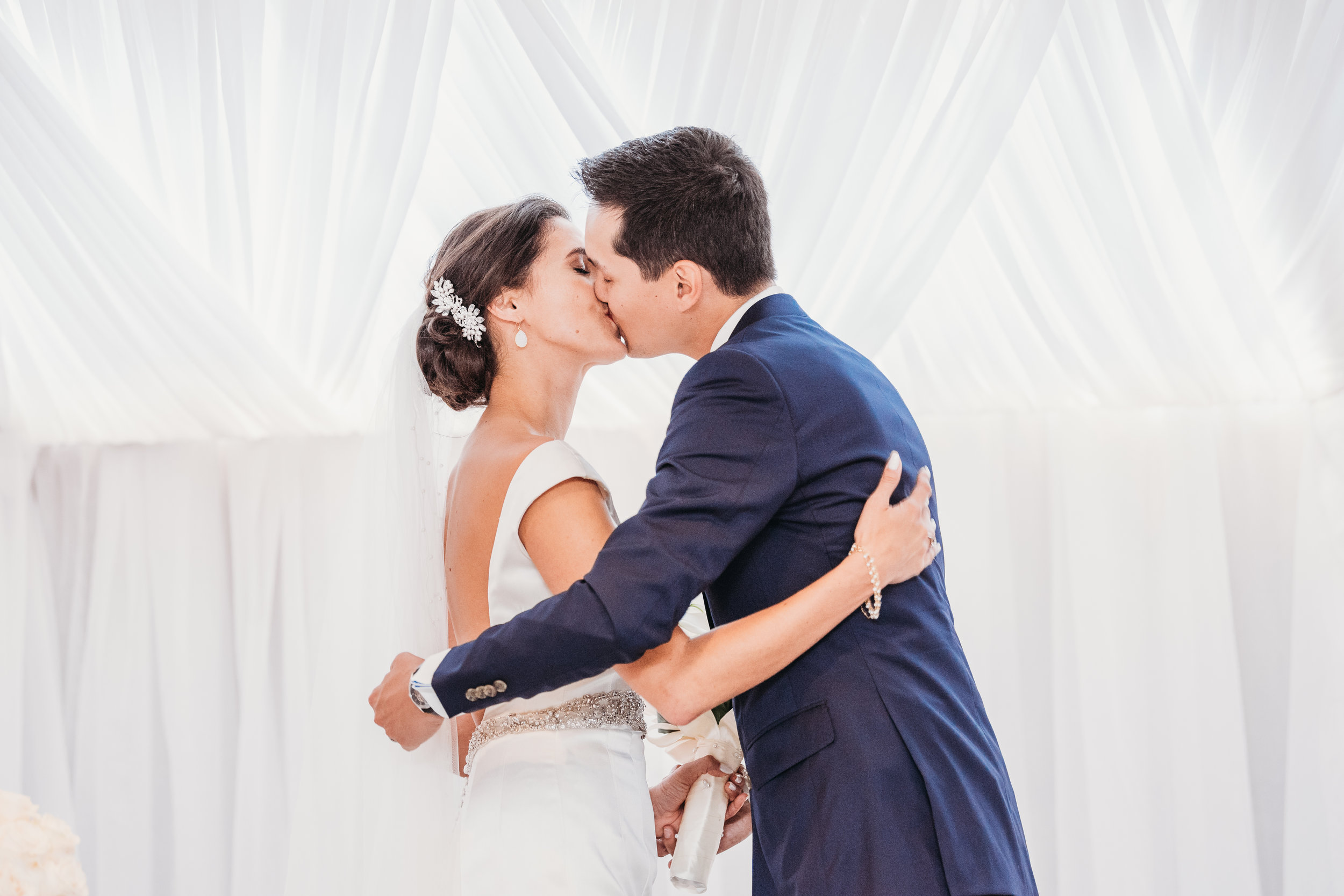 bride-groom-first-kiss-eglington-grand-wedding-by-willow-birch-photo-toronto-documentary-wedding-photographers.jpg