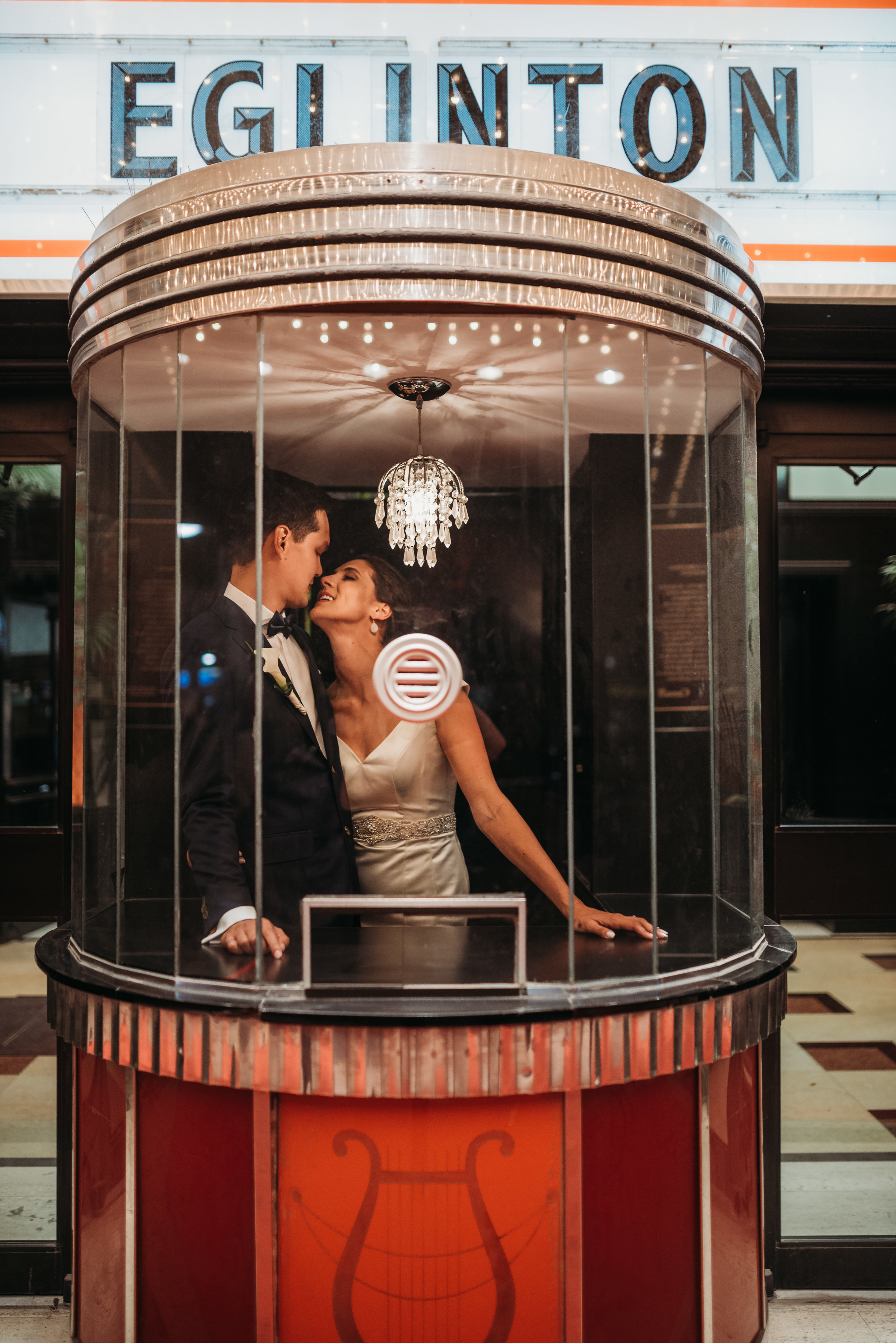 bride-groom-in-ticket-booth-eglington-grand-wedding-by-willow-birch-photo-toronto-documentary-wedding-photographers.jpg