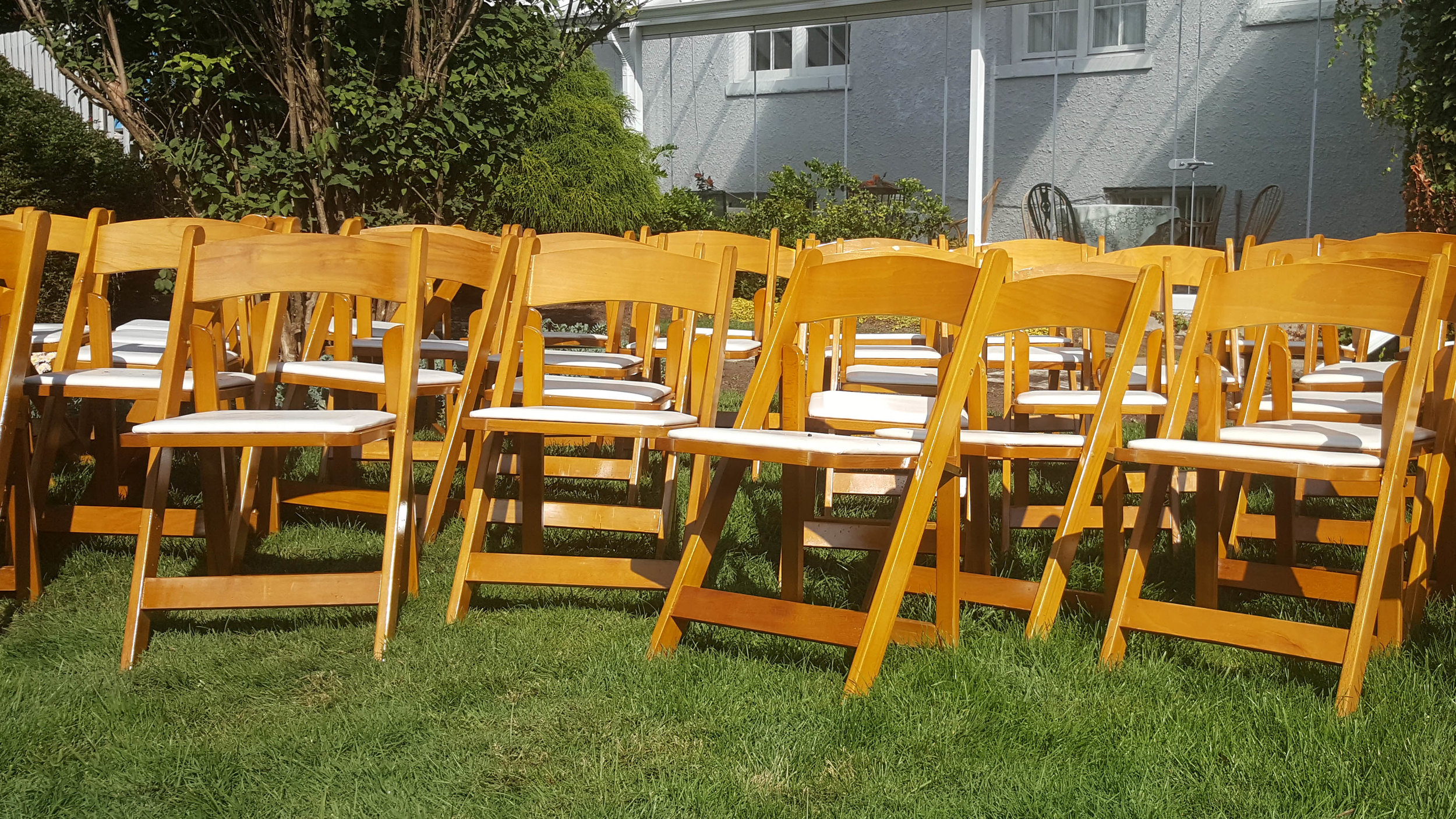 Folding Chairs - Service Type: RentalFinish: Natural glossPadding: White cushionMaterial: Wood