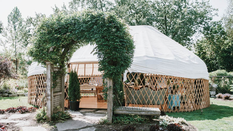 Signature Long Barn Yurt - Service Type: RentalSize: 23 feet x 33 feetCapacity: up to 100 peopleFlooring: Grass / Solid maple wood