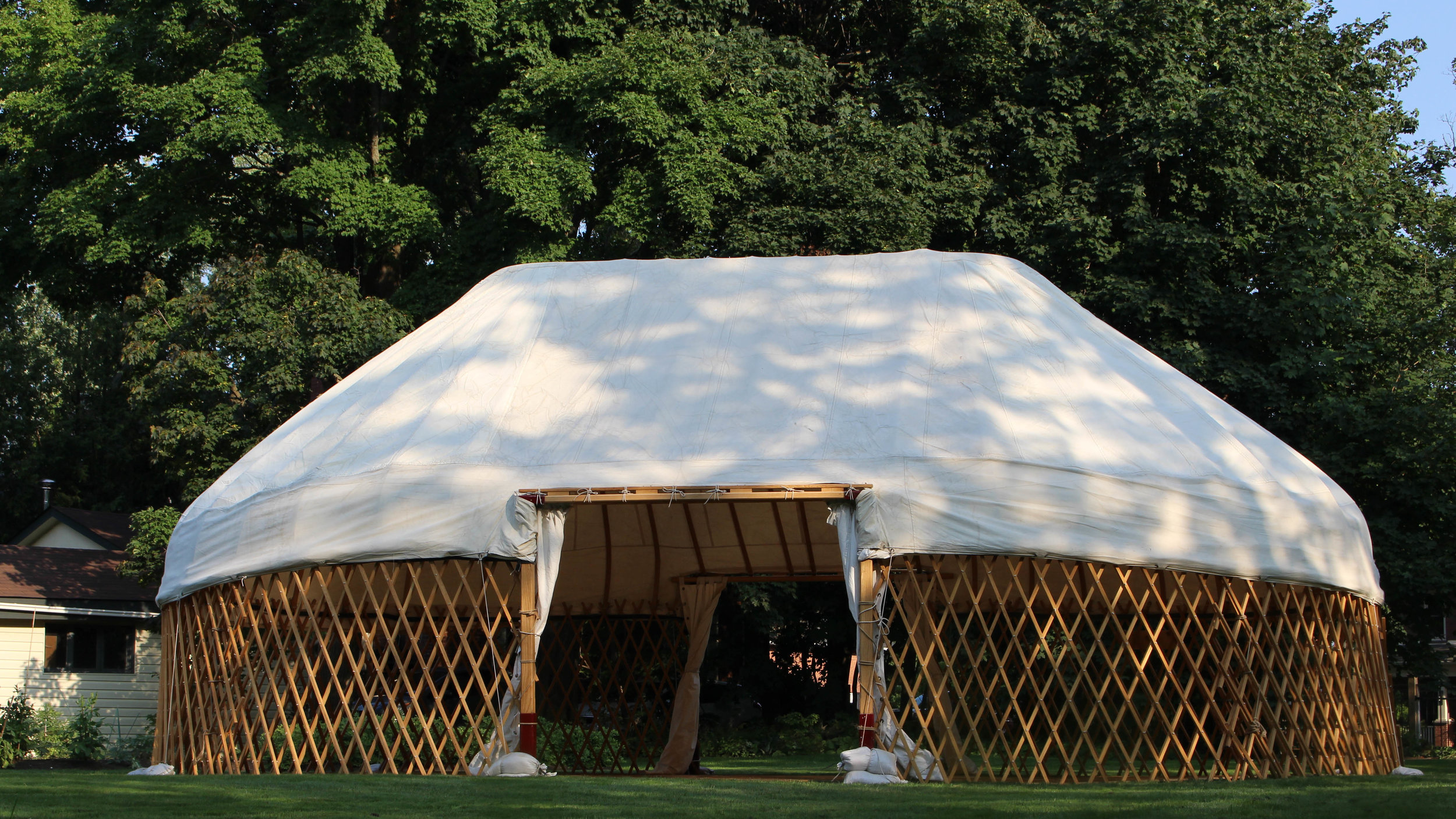 Signature Long Barn Yurt - Service Type: RentalSize: 23 feet x 33 feetCapacity: Up to 80 peopleSide Canvas Coverage: Yes/OptionalHeating/Cooling Option: Available