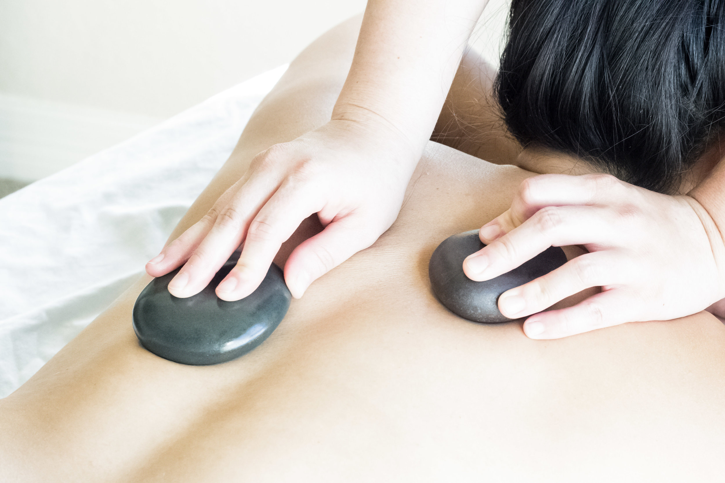 hot stone therapy   Hot Stone Therapy is a form of bodywork that involves the use of heated stones within a massage. Round, smooth stones are heated to a wonderfully warm temperature, and used to massage the body.The heat penetrates the muscle tissue, allowing the therapist to work deeper and faster. The heat helps to melt away tension, eases muscle stiffness and increases circulation. The hot stones create a sedative effect that can help to relieve pain, reduce stress and promote deep relaxation.