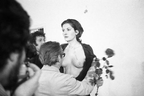Marina Abramović. Performing her public performance art piece 'Rhythm 0' in 1974. Photographer unknown.