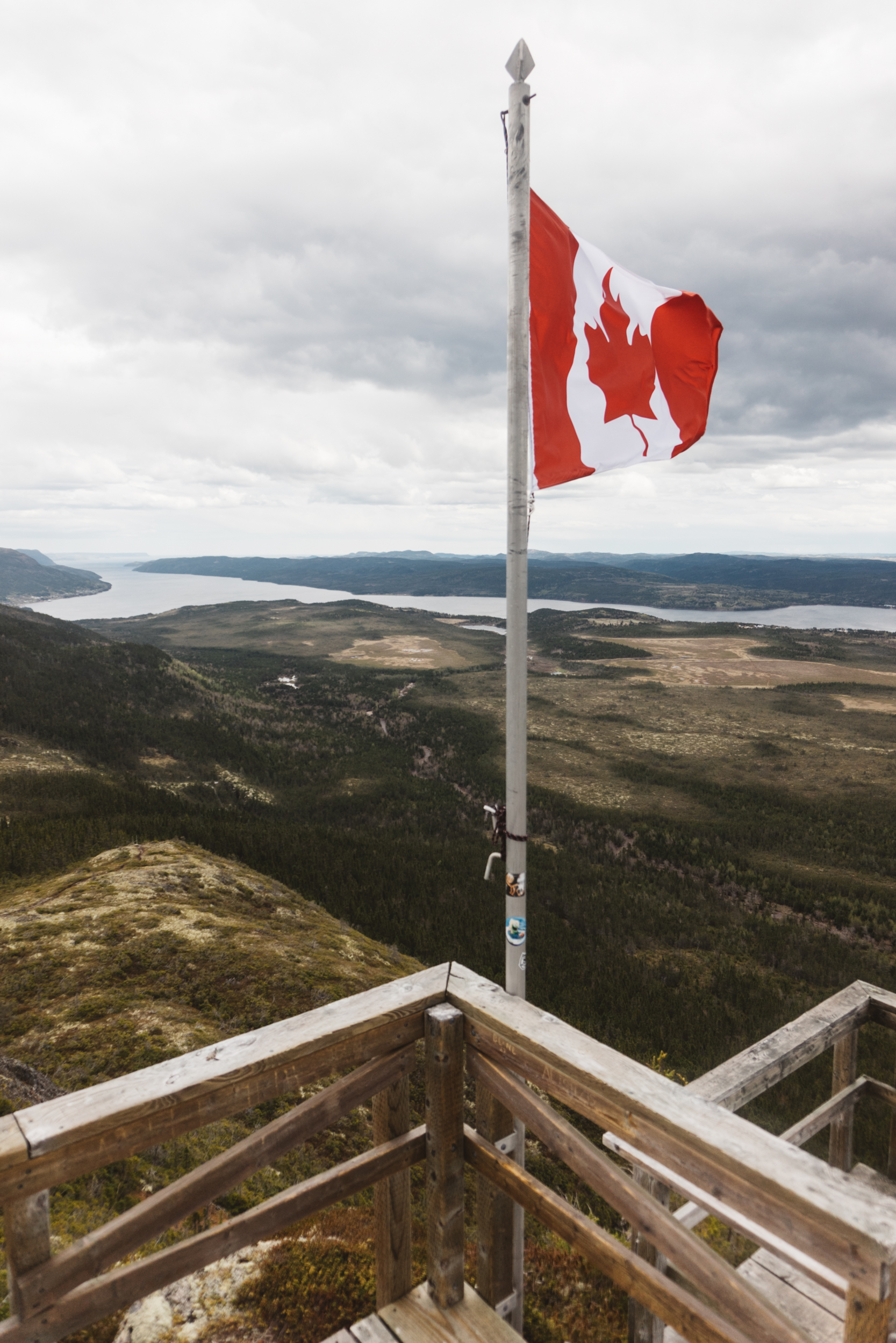 Canadian flag at the top of the mountain.