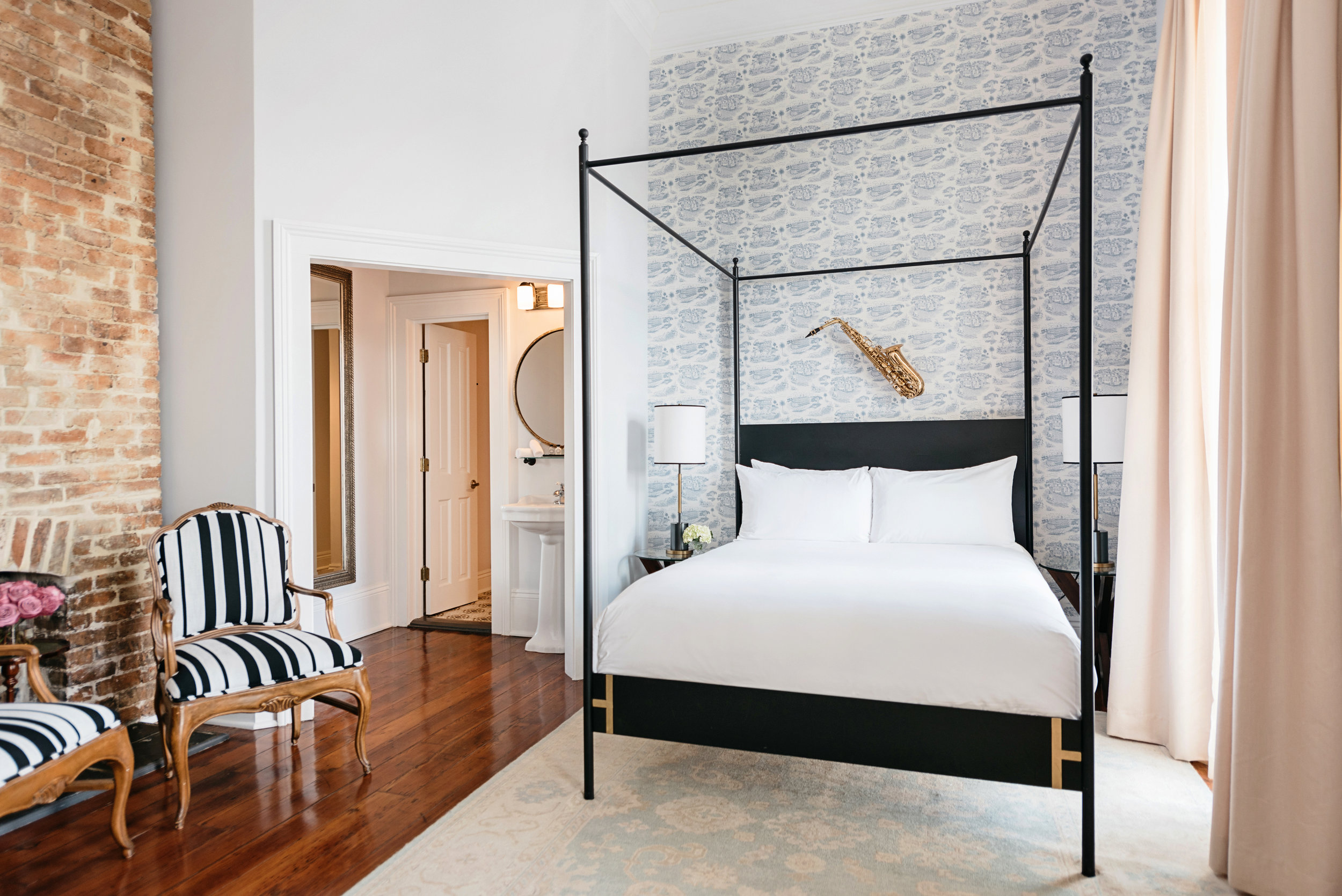 queen royal - Sleeps two in a Queen sculptural iron canopy bed with the highest-quality linens. Relaxing seating area, 12-foot ceilings, antique armoires, and floor-to-ceiling windows. Antique architectural surprises throughout.