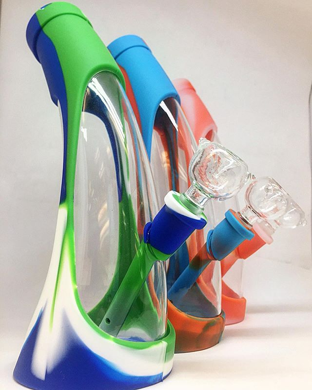 """Looking for the durability or silicone, but like the transparency of glass?  We got you 👌🏼 These curved glass bongs with silicone wraps are just what you've been looking for.  #Greenlife #AlaskaCannabis #SmokingAccessories #SiliconeBong #Bong  Greenlife Supply Co. License 11927 (1) """"Marijuana has intoxicating effects and may be habit forming and addictive.""""; (2) """"Marijuana impairs concentration, coordination, and judgement.  Do not operate a vehicle or machinery under its influence.""""; (3) """"There are health risks associated with consumption of marijuana.""""; (4) """"For use only by adults twenty-one and older.  Keep out of the reach of children.""""; (5) """"Marijuana should not be used by women who are pregnant or breast feeding."""""""