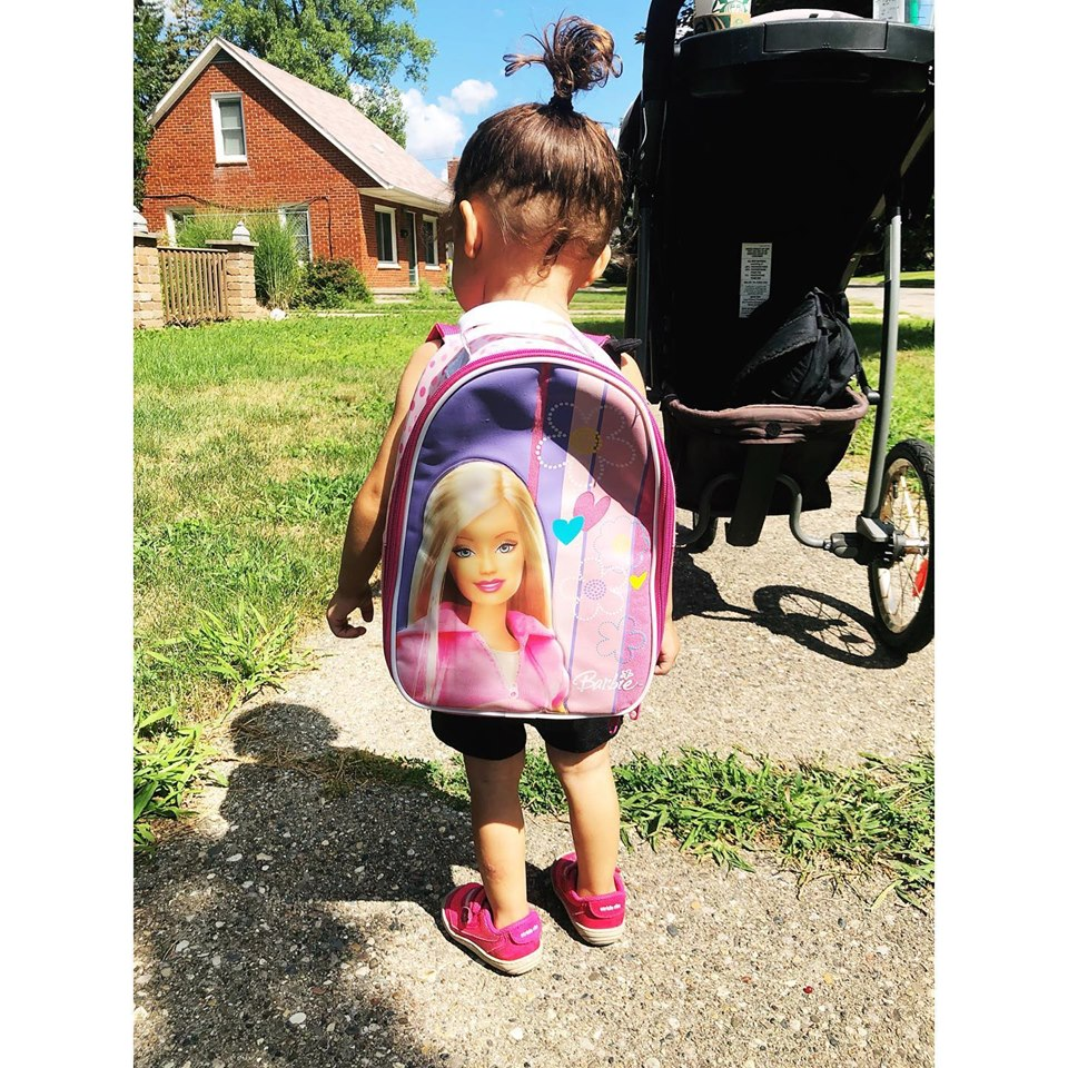 Izzy, carrying her thrifted Barbie backpack. August 2019.
