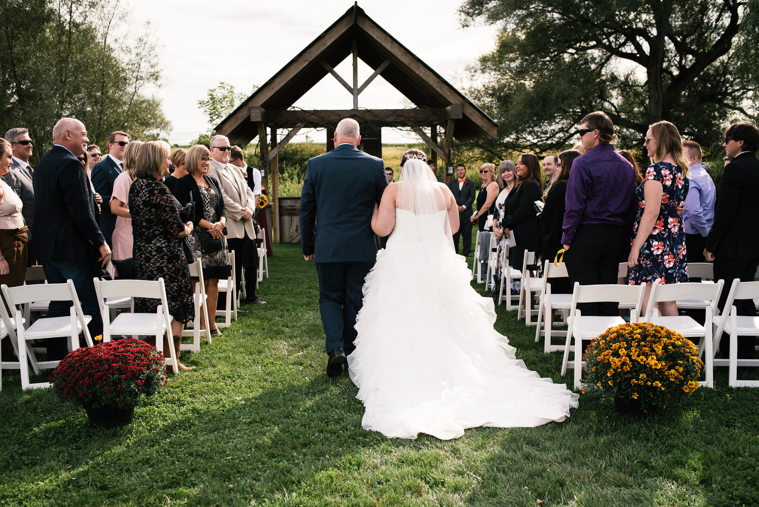 Bride walking down the aisle at Willow Creek Barn Events.