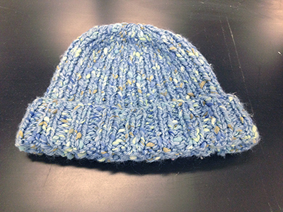 "Record Number: 001 Collection Date: 12 June 2017  Description: Blue, hand-knit, cotton cap Dimension: 10"" x 8"""
