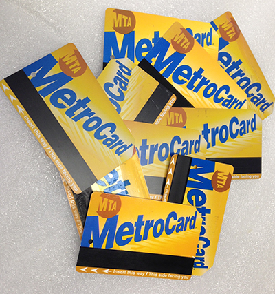 "Record Number: 021 Collection Date: 21 Oct 2017  Description: Ten NY subway cards. Paper with magnetic strip, yellow, blue, orange, white, brown Dimension: 2.125"" x 3.125"" each"