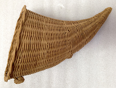 "Record Number: 028 Collection Date: 21 Oct 2017  Description: Wicker cornucopia basket, table decoration, symbol of abundance Dimension: 7.5"" x 14"" x .5"""
