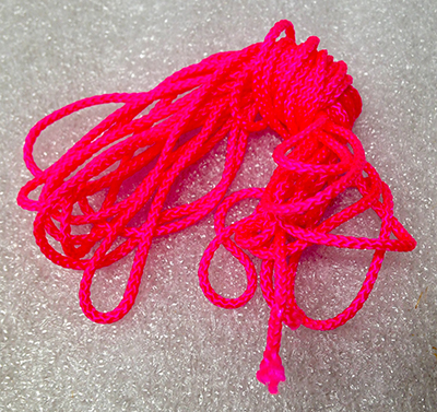 "Record Number: 029 Collection Date: 21 Oct 2017  Description: Neon pink string Dimension: 3.5"" x 1.5"" x .5"""