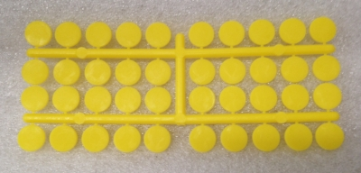 "Record Number: 039 Collection Date: 21 Oct 2017  Description: Bright yellow plastic chips used for board game Dimension: 2.5"" x 6"""