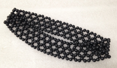 "Record Number: 051 Collection Date: 20 Nov 2017  Description: Headband, black beads, used to hold hair back Dimension: .5"" x 8"" x 1.5"""