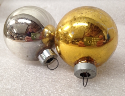 "Record Number: 054 Collection Date: 20 Nov 2017  Description: Christmas ornaments, metallic silver and gold Dimension: 2.25"" x 1.75"" each"