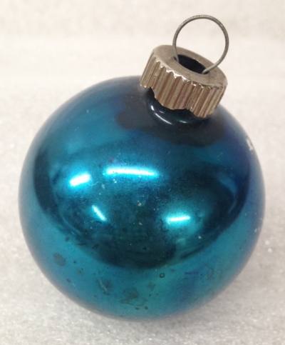 "Record Number: 059 Collection Date: 20 Nov 2017  Description: Christmas ornament, metallic blue Dimension: 2.25"" x 1.75"""