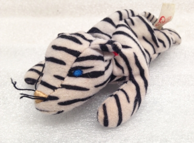"Record Number: 075 Collection Date: 24 Nov 2017  Description: Stuffed animal, black and white stripes Dimension: 3"" x 8"" x 3"""