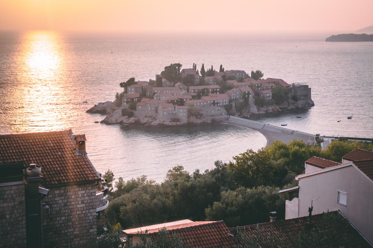 A small little island off the coast, sunset. It sure looks nice.