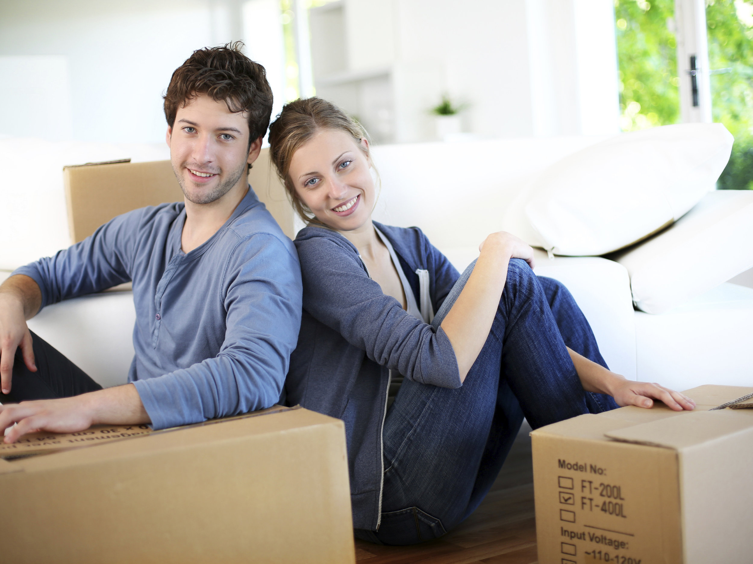 young-couple-sitting-in-house-with-boxes-mt2015.jpg