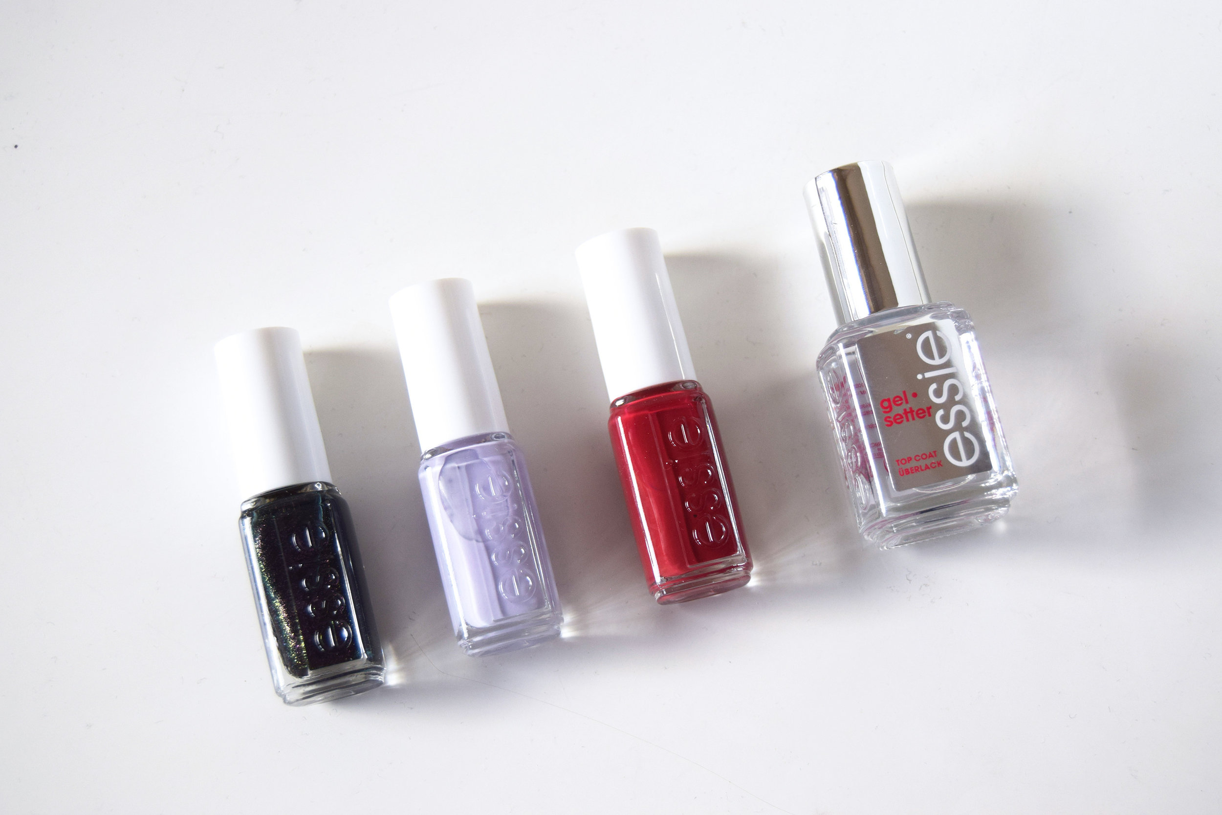 From left to right: Essie 'Haute Tub', 'Virgin Snow', 'Shall We Chalet?' and a Gel Setter top coat.