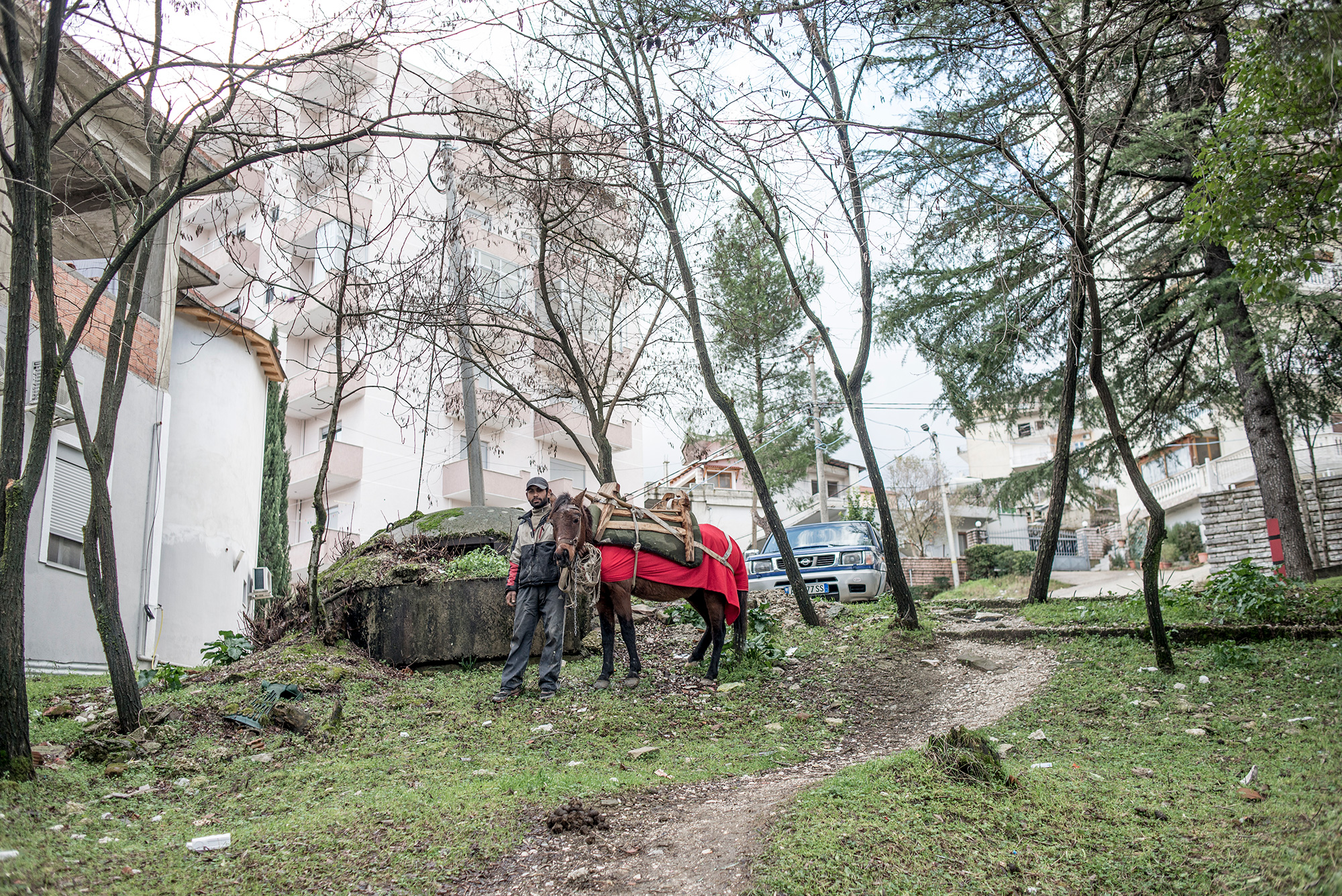 A gypsy with a horse stands by a bunker, Gjirokaster - Albania