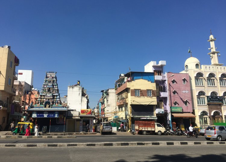 On the left is a Hindu temple and on the right is a mosque.