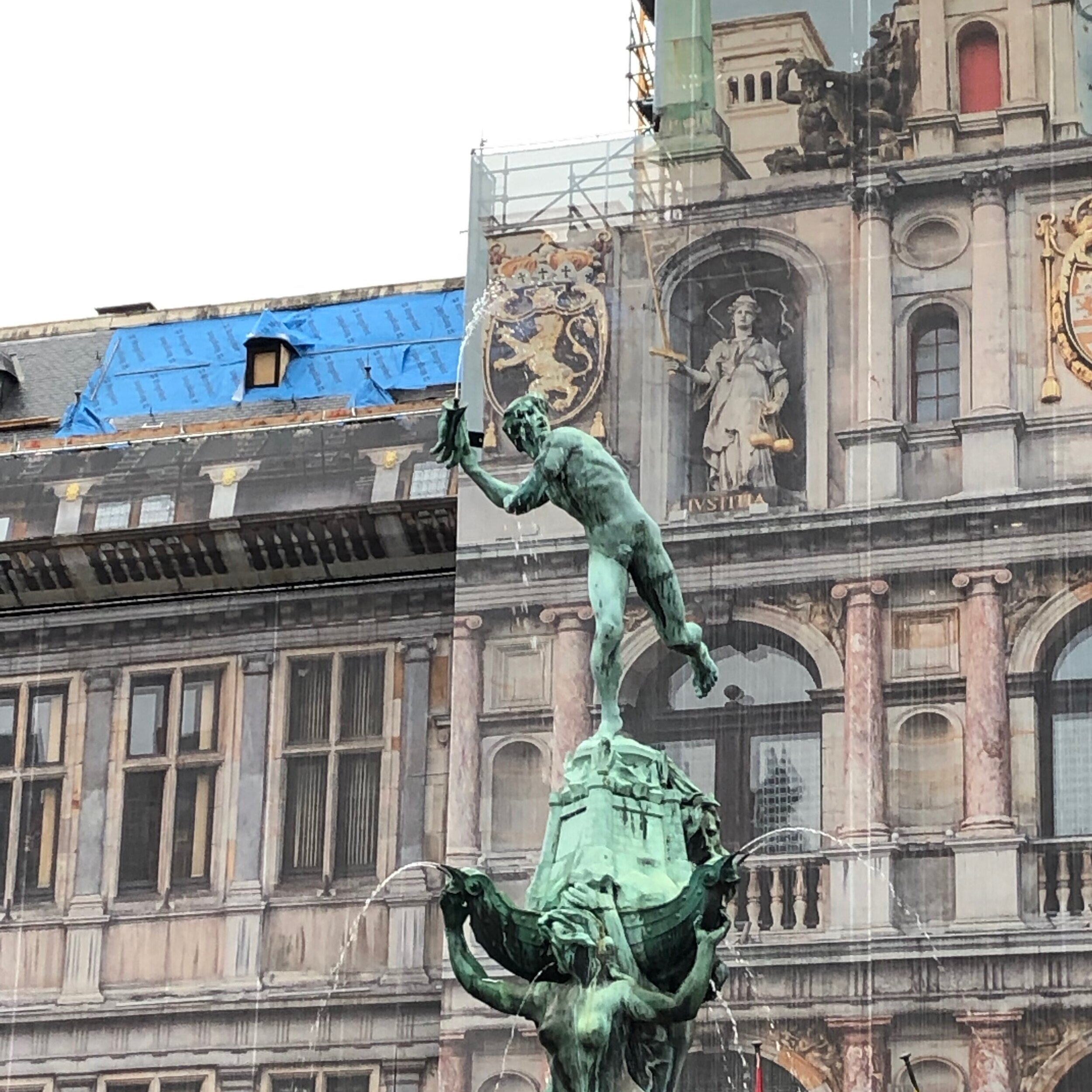 Antwerp City Hall with statues depicting the city's eponymous legend