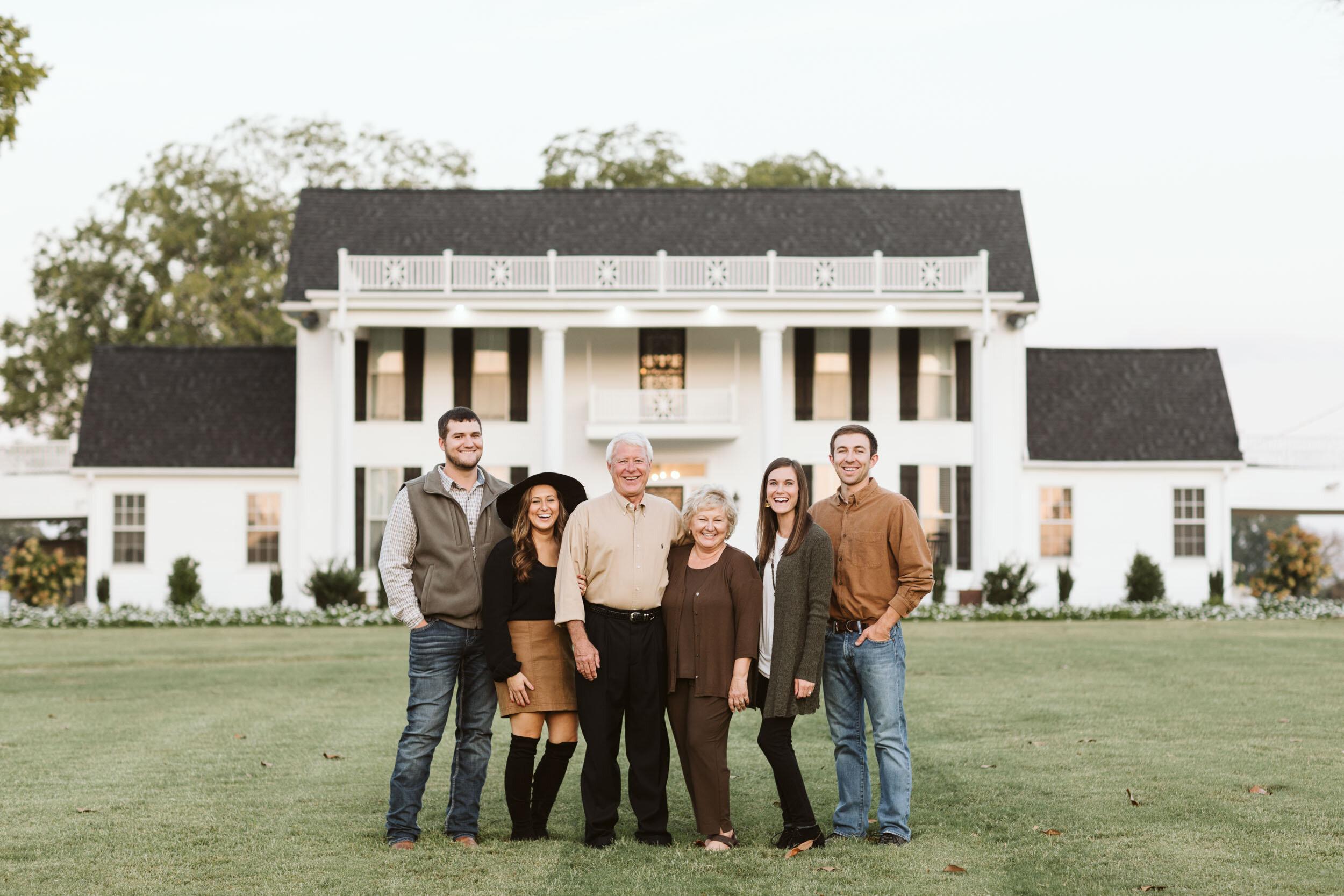 The Hendren Family standing outside the Manor at Mount Carmel