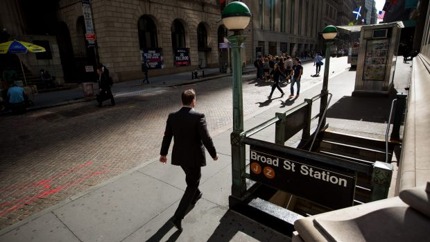 Could another GFC happen? A pedestrian walks along Wall Street near the New York Stock Exchange.  Photo: Michael Nagle