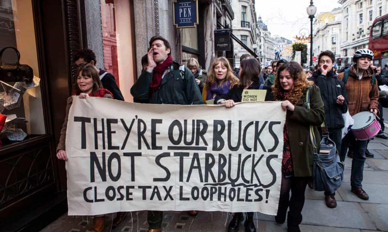 A protest in London against Starbucks corporate tax policies. Photograph: Antonio Olmos/The Observer