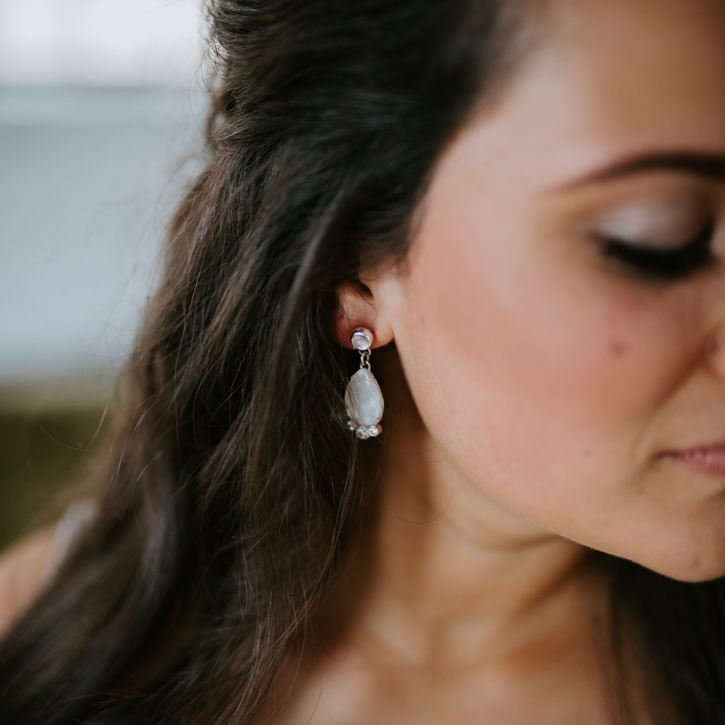 Kayleigh - Kayleigh approached me a few months before her wedding saying that she was looking for a custom pair of earrings to wear on her special day. I couldn't have been happier! We set to work and thanks to her specific vision of what she wanted, I was able to create exactly what she wanted down to the size, stone and design. She couldn't be happier with how they turned out and I couldn't be either!